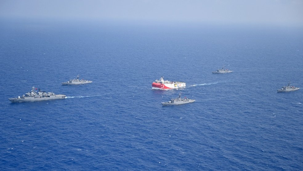 Turkey's research vessel Oruç Reis (C) is surrounded by Turkish navy vessels as it was heading toward the west of Antalya on the Mediterranean, Turkey, Aug. 10, 2020. (AP Photo)