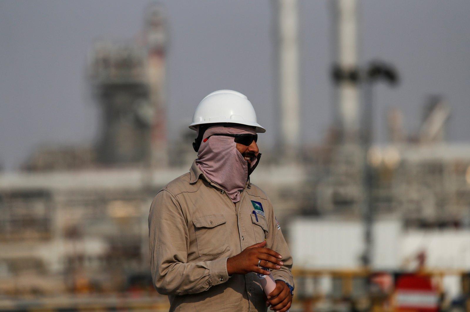 An employee looks on at the Saudi Aramco oil facility in Abqaiq, Saudi Arabia Oct. 12, 2019. (Reuters Photo)