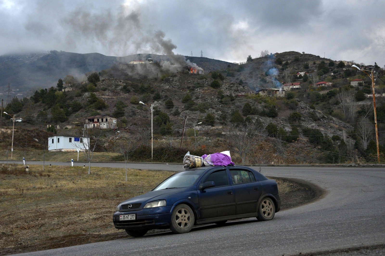 A car loaded with belongings moves on a road in front of the town of Lachin, Azerbaijan, Nov. 30, 2020. (AFP Photo)