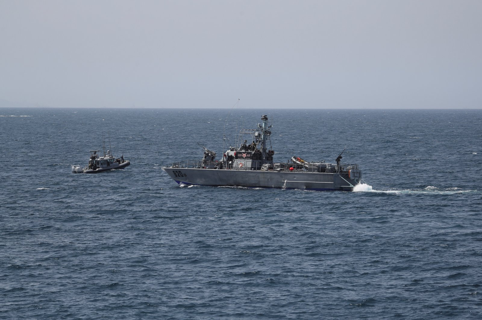 Israeli Navy boats are seen in the Mediterranean Sea as seen from Rosh Hanikra, close to the Lebanese border, northern Israel May 4, 2021. (Reuters Photo)