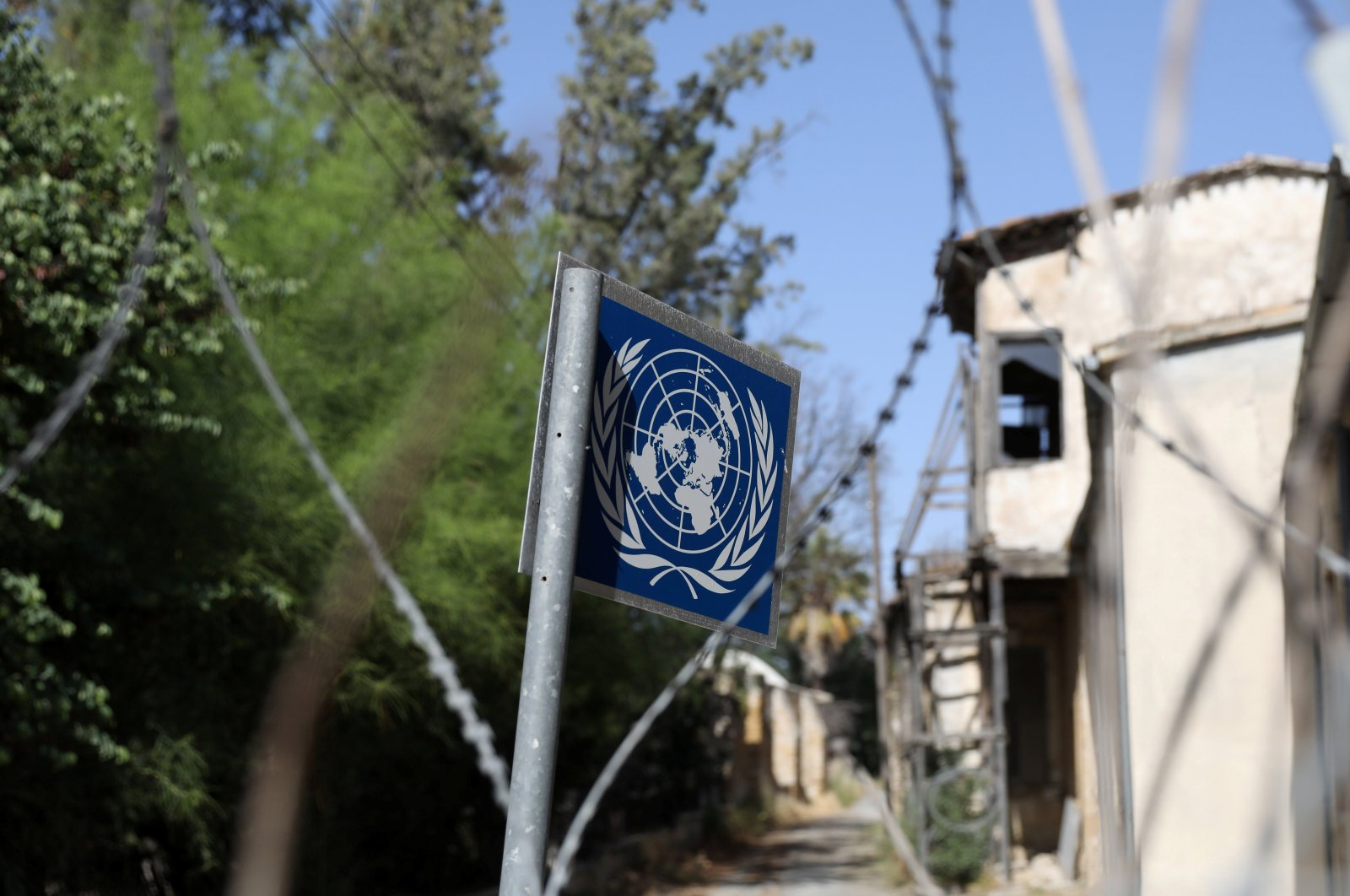 A United Nations sign is seen through barbed wire at the U.N.-controlled buffer zone in Nicosia (Lefkoşa), Cyprus April 28, 2021. (REUTERS Photo)