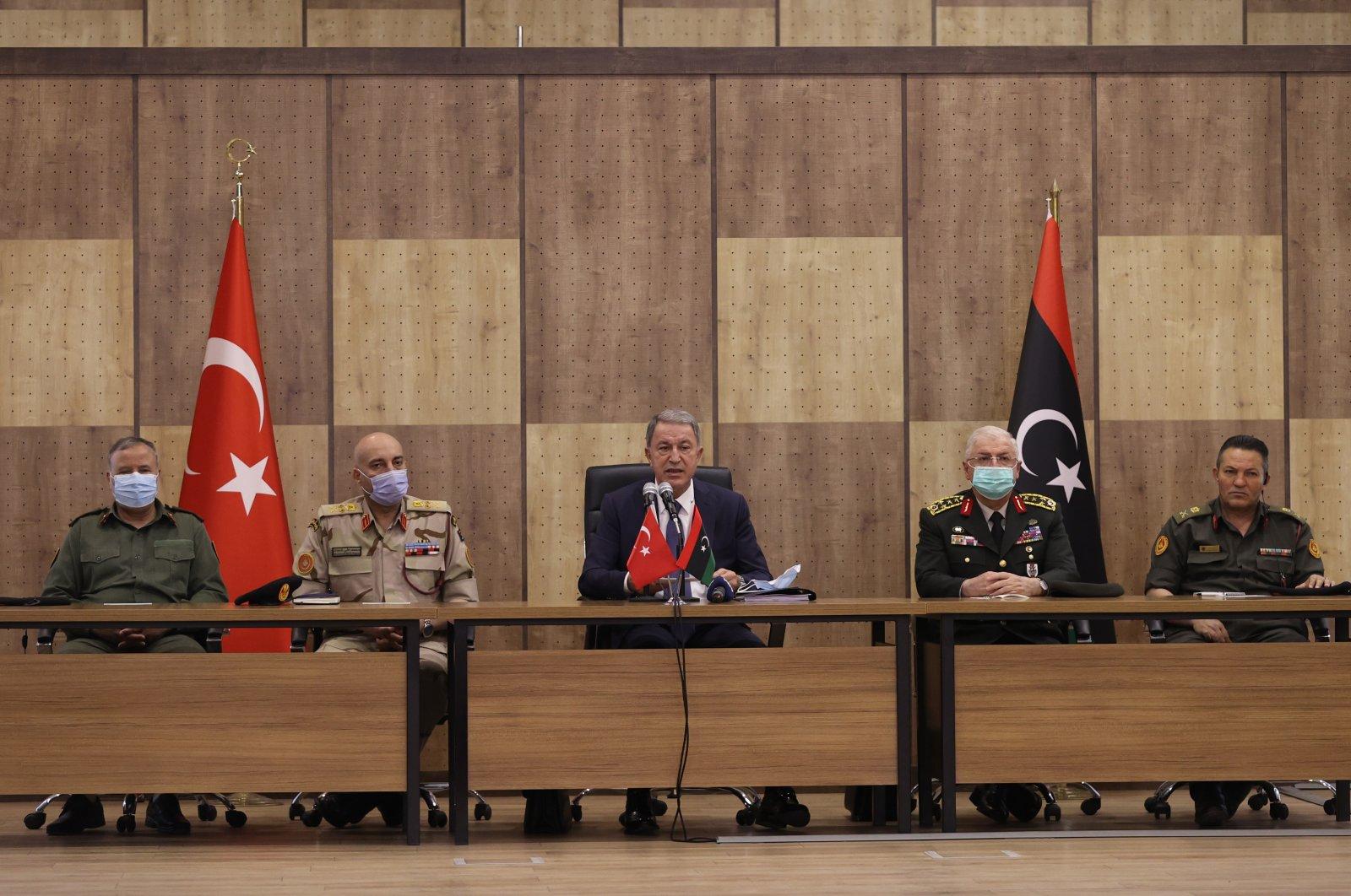 Turkey's Defense Minister Hulusi Akar (C) addresses Turkish military personnel in Tripoli, Libya, May 4, 2021. (AA Photo)