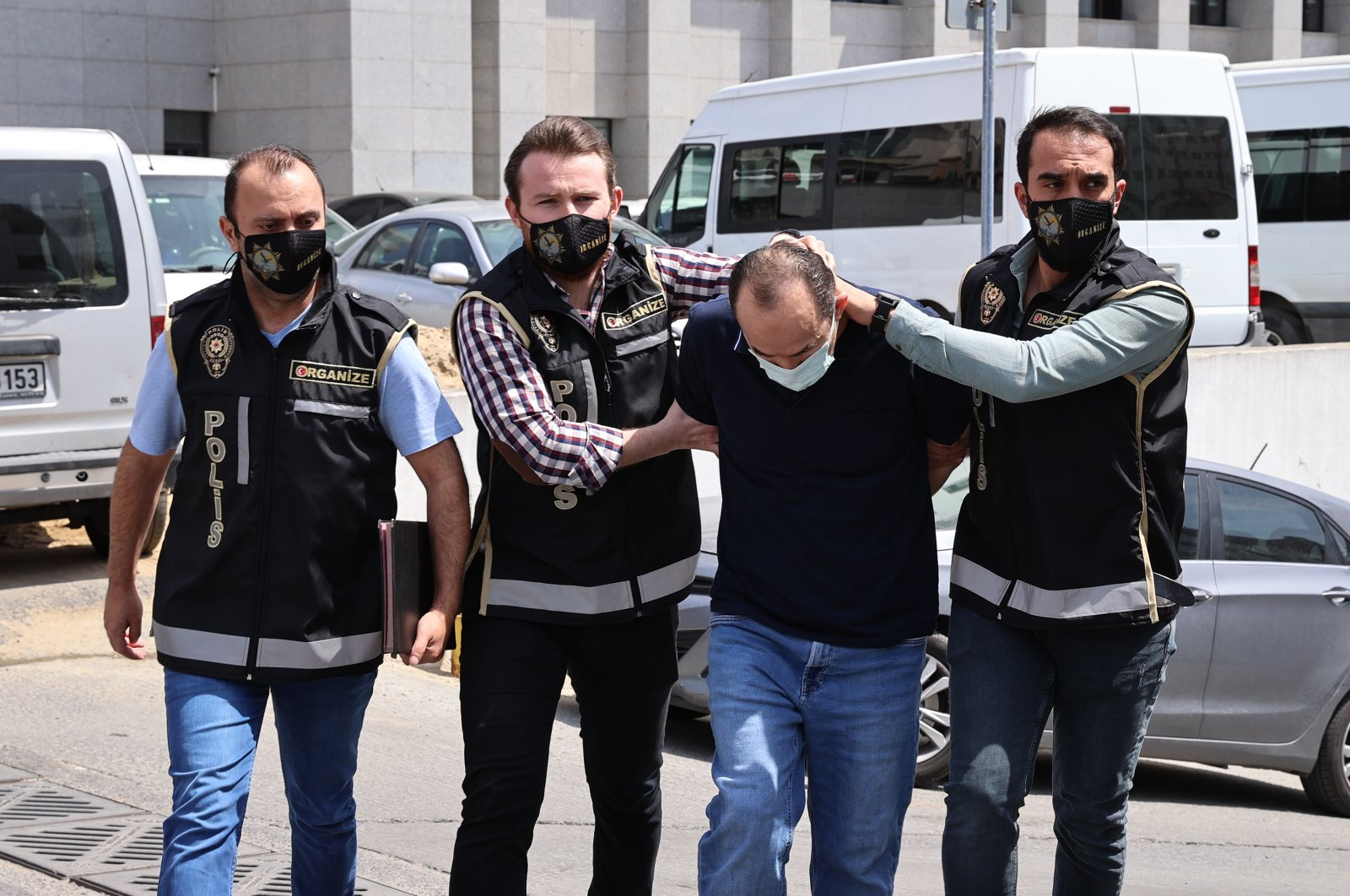 Police officers escort İbrahim Tatar to the courthouse, in Istanbul, Turkey, May 4, 2021. (AA PHOTO)