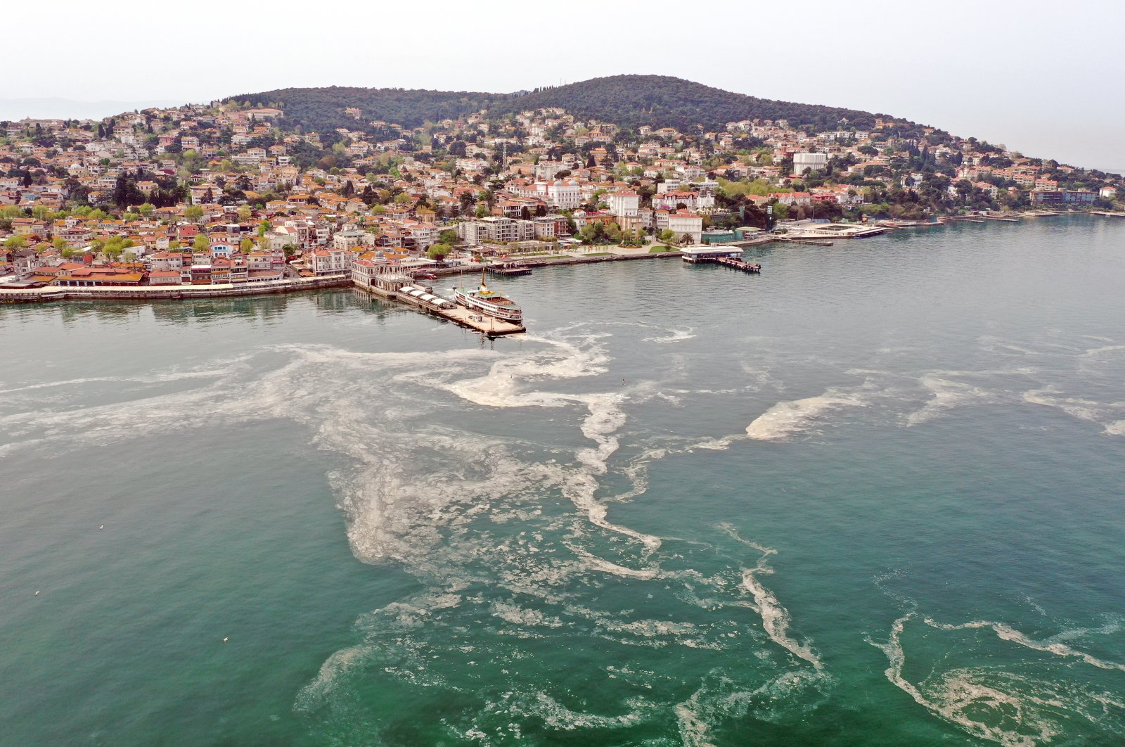 The sea snot is seen in this aerial picture taken near the pier of Büyükada, the largest of Istanbul's Princes Islands, in the Marmara sea, Turkey, May 2, 2021. (AA Photo)