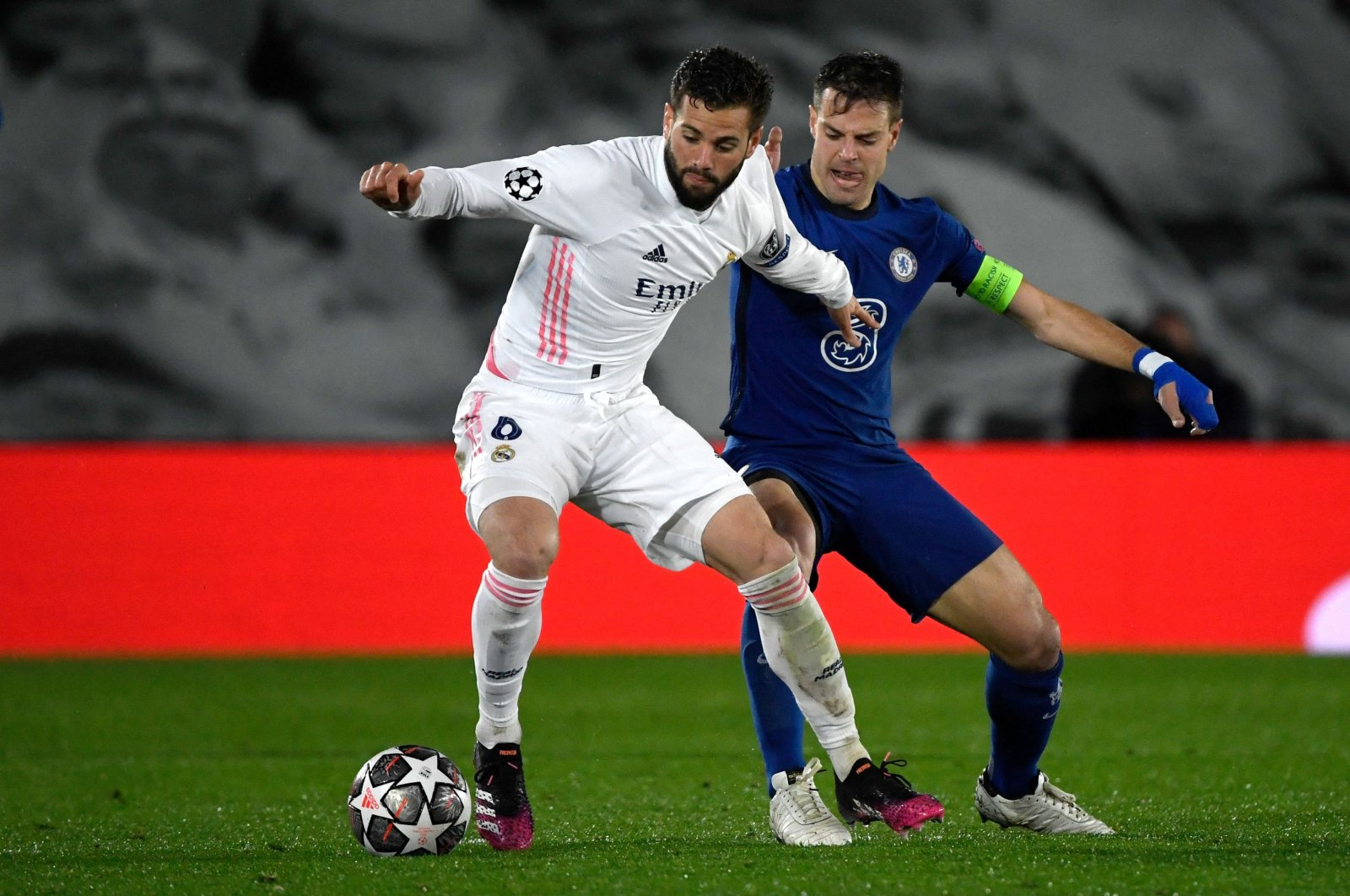 Real Madrid defender Nacho Fernandez (L) vies with Chelsea's Spanish defender Cesar Azpilicueta during the UEFA Champions League semifinal first leg match at the Alfredo di Stefano Stadium, Madrid, Spain, April 27, 2021. (AFP Photo)