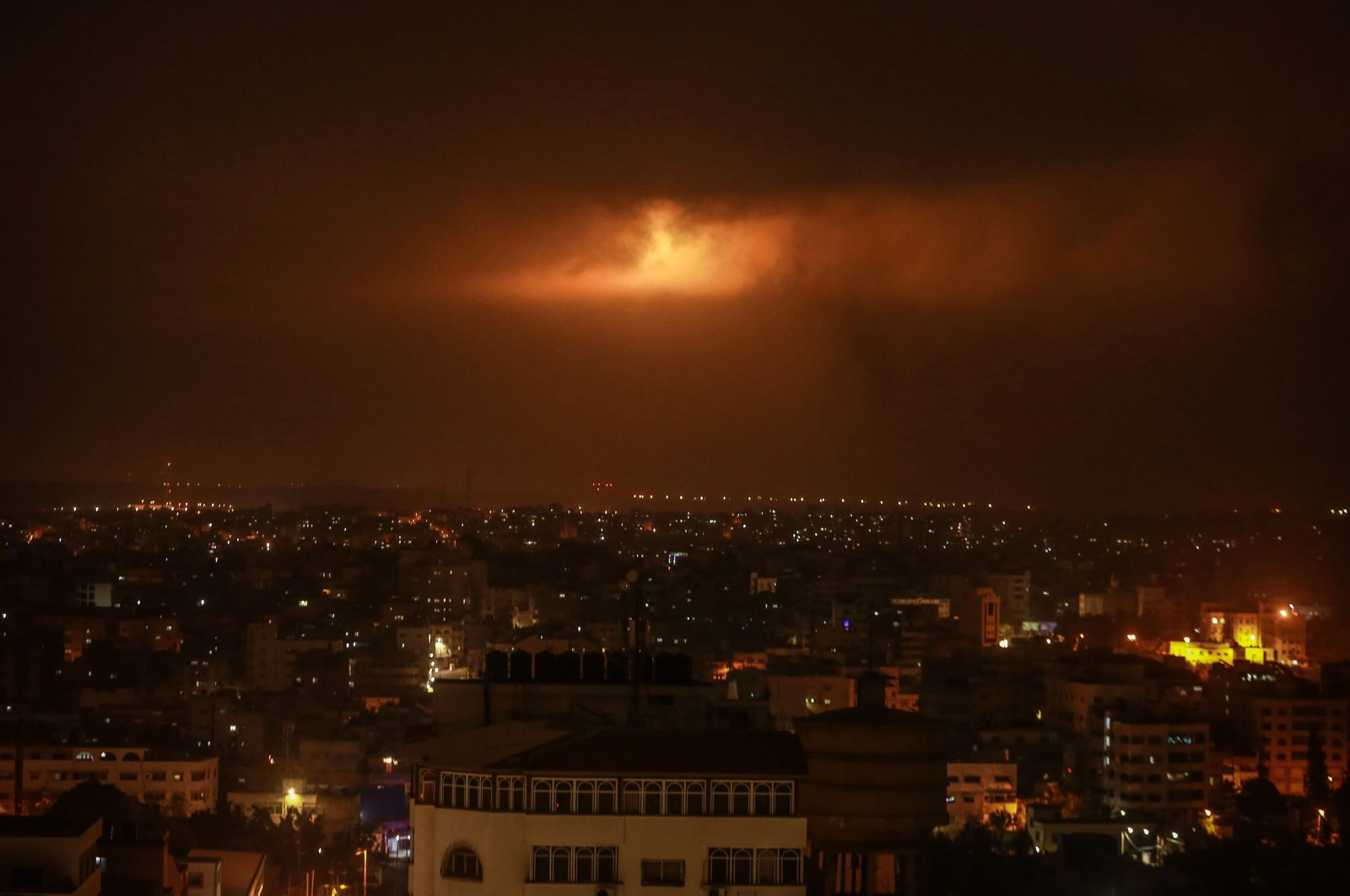 Lighting bombs fired by the Israeli army can be seen through the clouds after the Palestinian protests in Gaza City, Palestine, April 24, 2021. (Photo  by Getty Images)