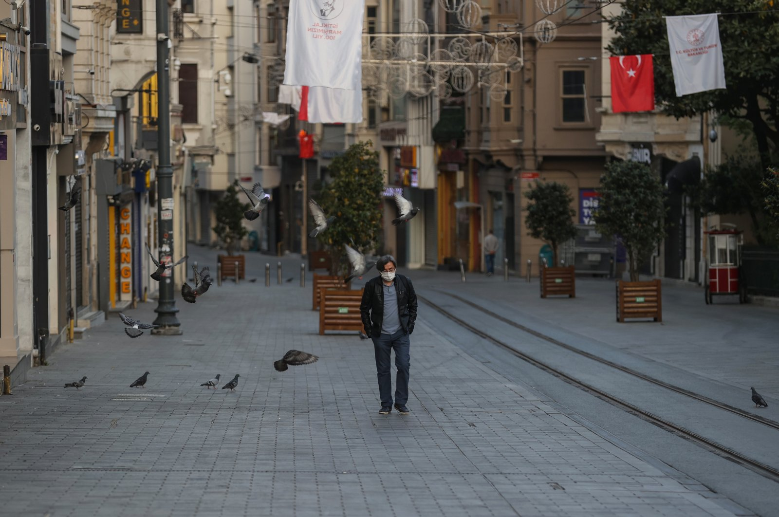 A man walks on otherwise busy Istiklal Avenue, in Istanbul, Turkey, May 3, 2021. (AA PHOTO)