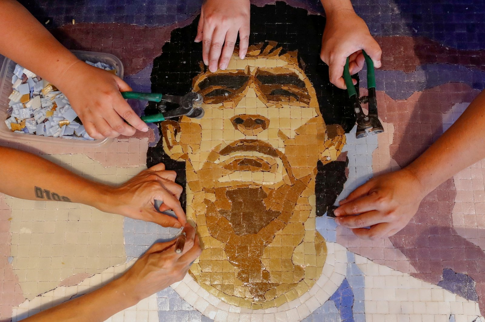 Members of the cultural organization Comando Maradona, prepare a mosaic as a homage to late Argentine football icon Diego Armando Maradona, at their workshop in Buenos Aires, Argentina Feb. 24, 2021. (Reuters Photo)