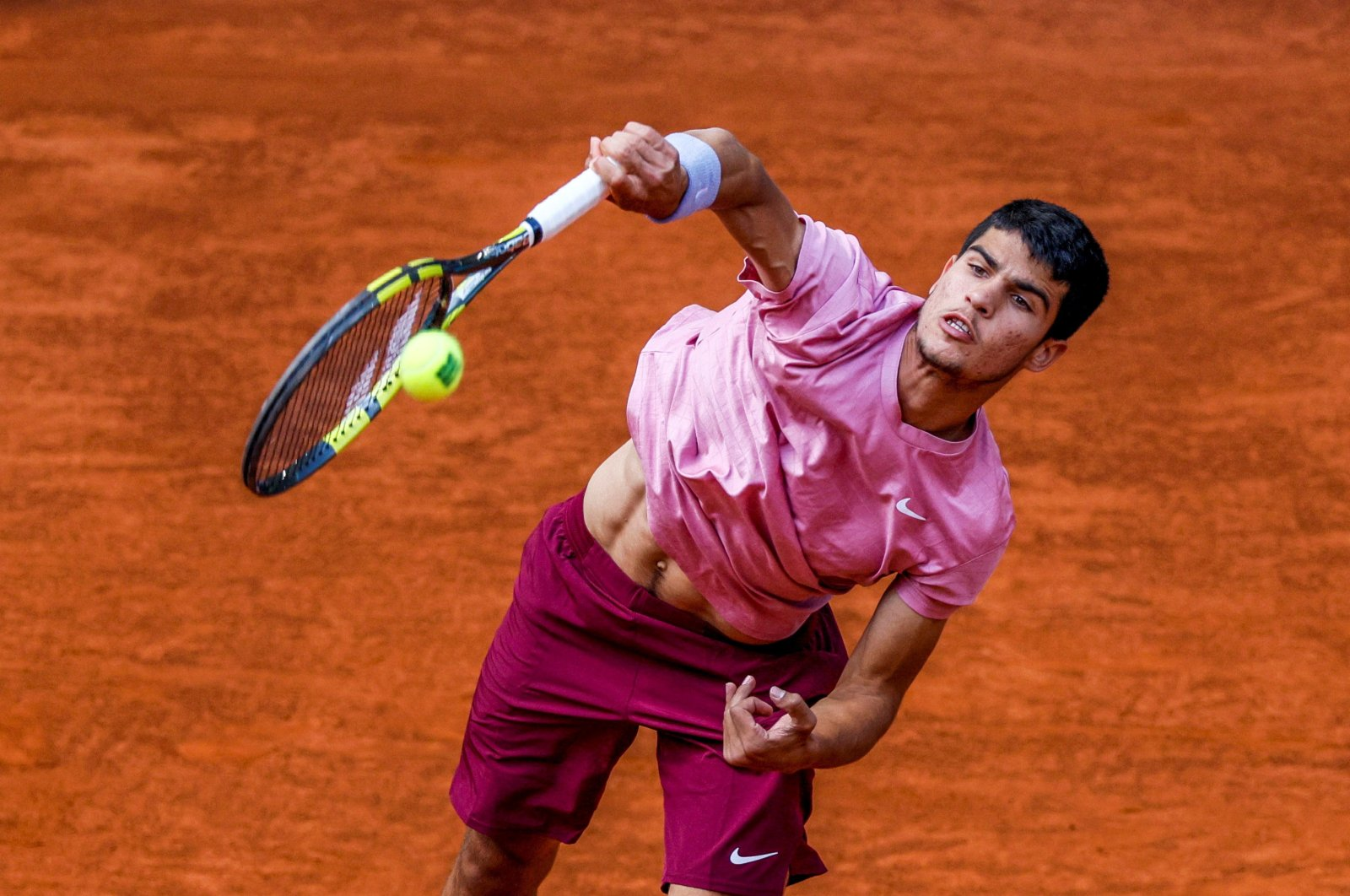 Spain's Carlos Alcaraz in action against France's Adrian Mannarino at the Mutua Madrid Open tennis tournament, Madrid, Spain, May 03, 2021. (EPA Photo)