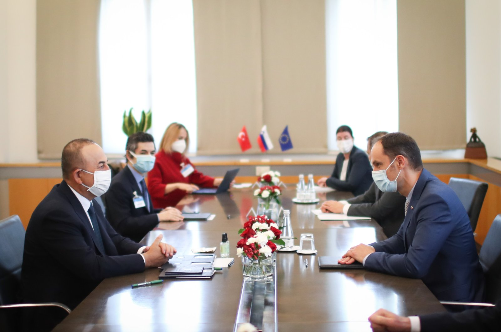 Foreign Minister Mevlüt Çavuşoğlu (L) and his delegation attend a meeting with Slovenian Foreign Minister Anze Logar (R) in Ljubljana, Slovenia, May 4, 2021. (AA Photo)