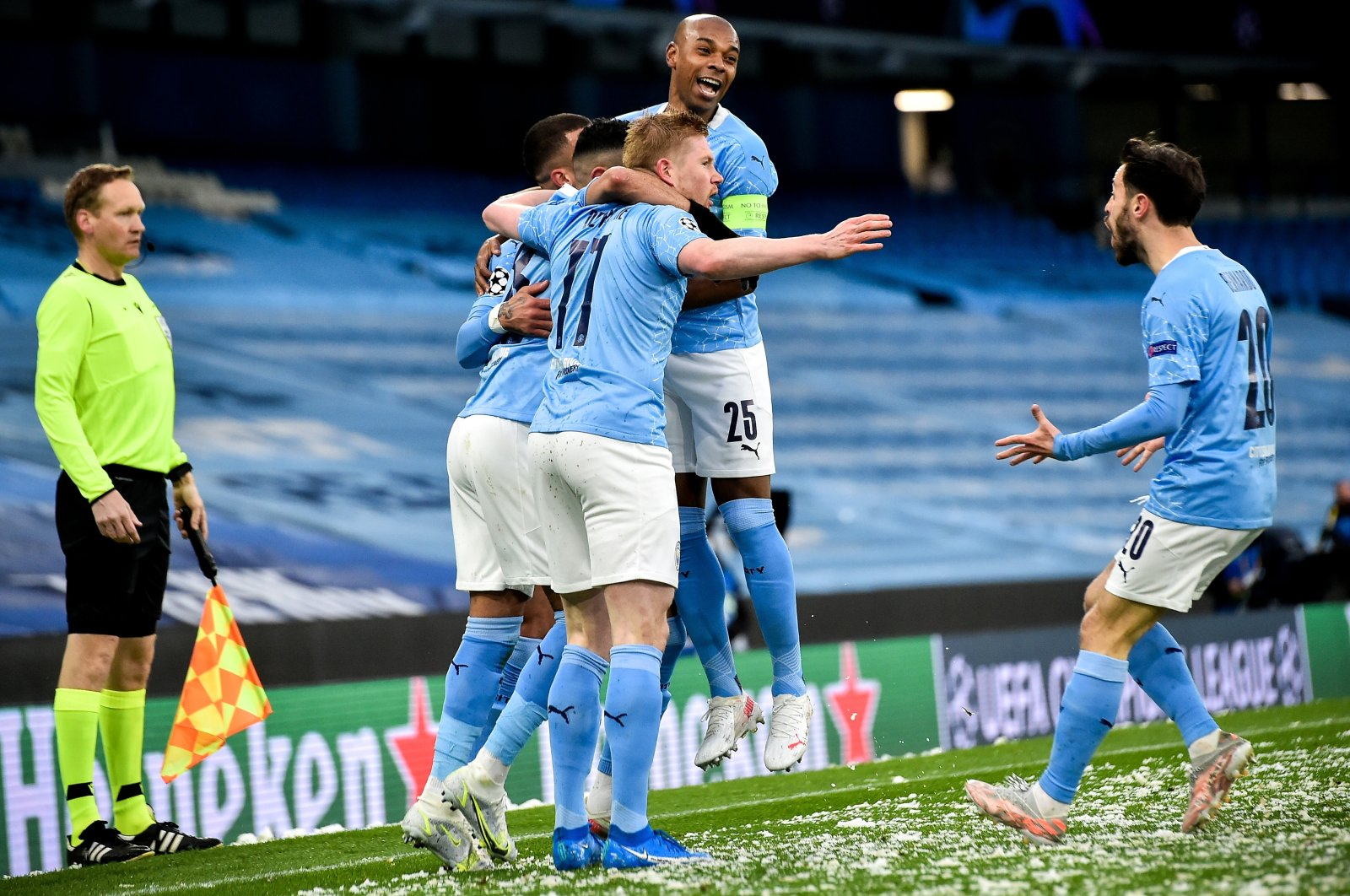 Manchester City's Fernandinho (C) and his teammates celebrate their team's 1-0 lead during the UEFA Champions League semi final, second leg soccer match between Manchester City and Paris Saint-Germain in Manchester, Britain, 04 May 2021. (EPA Photo)