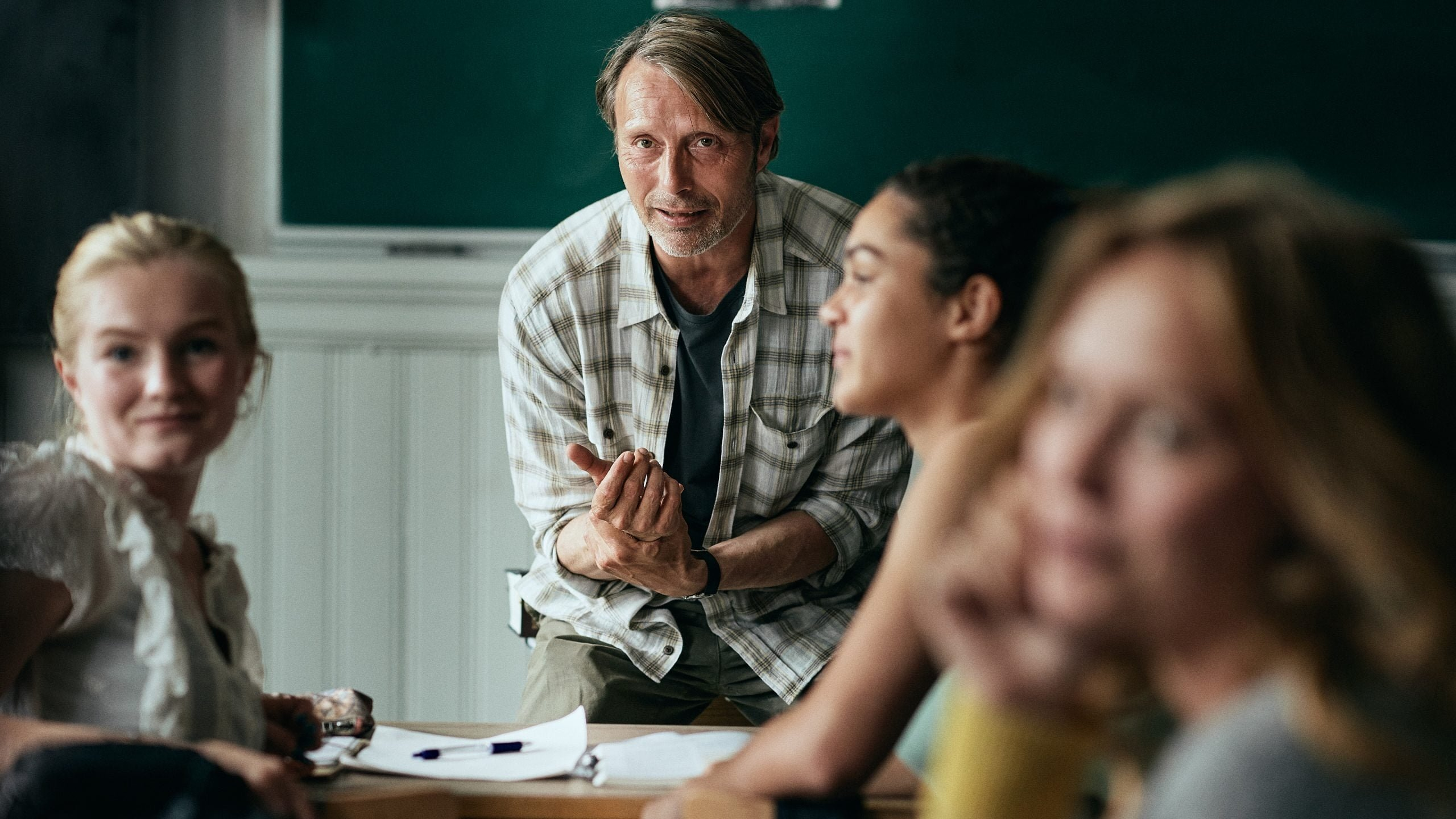 Actor Mads Mikkelsen as history teacher Martin (C) with his students in a still shot from 'Another Round.'