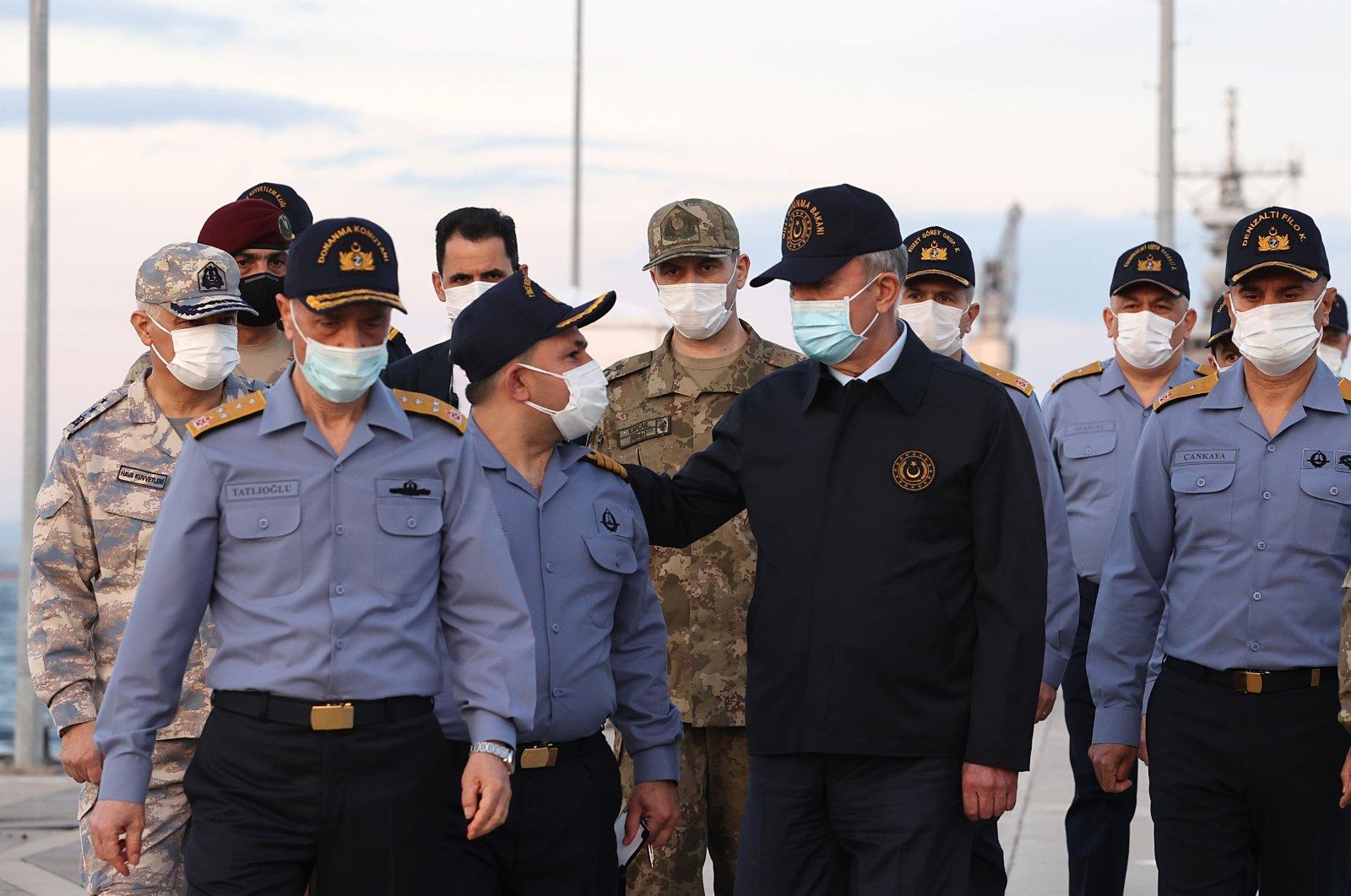 Defense Minister Hulusi Akar (in black) visits Gölcük Fleet Command in Kocaeli province, Turkey, May 5, 2021. (AA Photo)