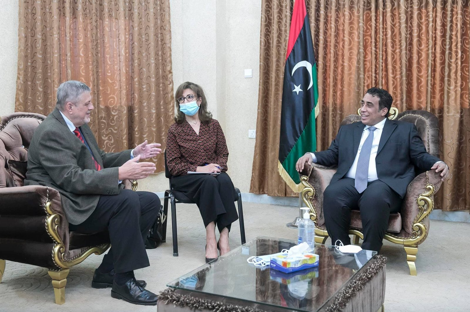 Jan Kubis, the United Nation's special envoy for Libya, (L) and Mohammad Younes Menfi, the head of Libya's Presidential Council, talk during a meeting in Tripoli, Libya, April 29, 2021. (AA Photo)