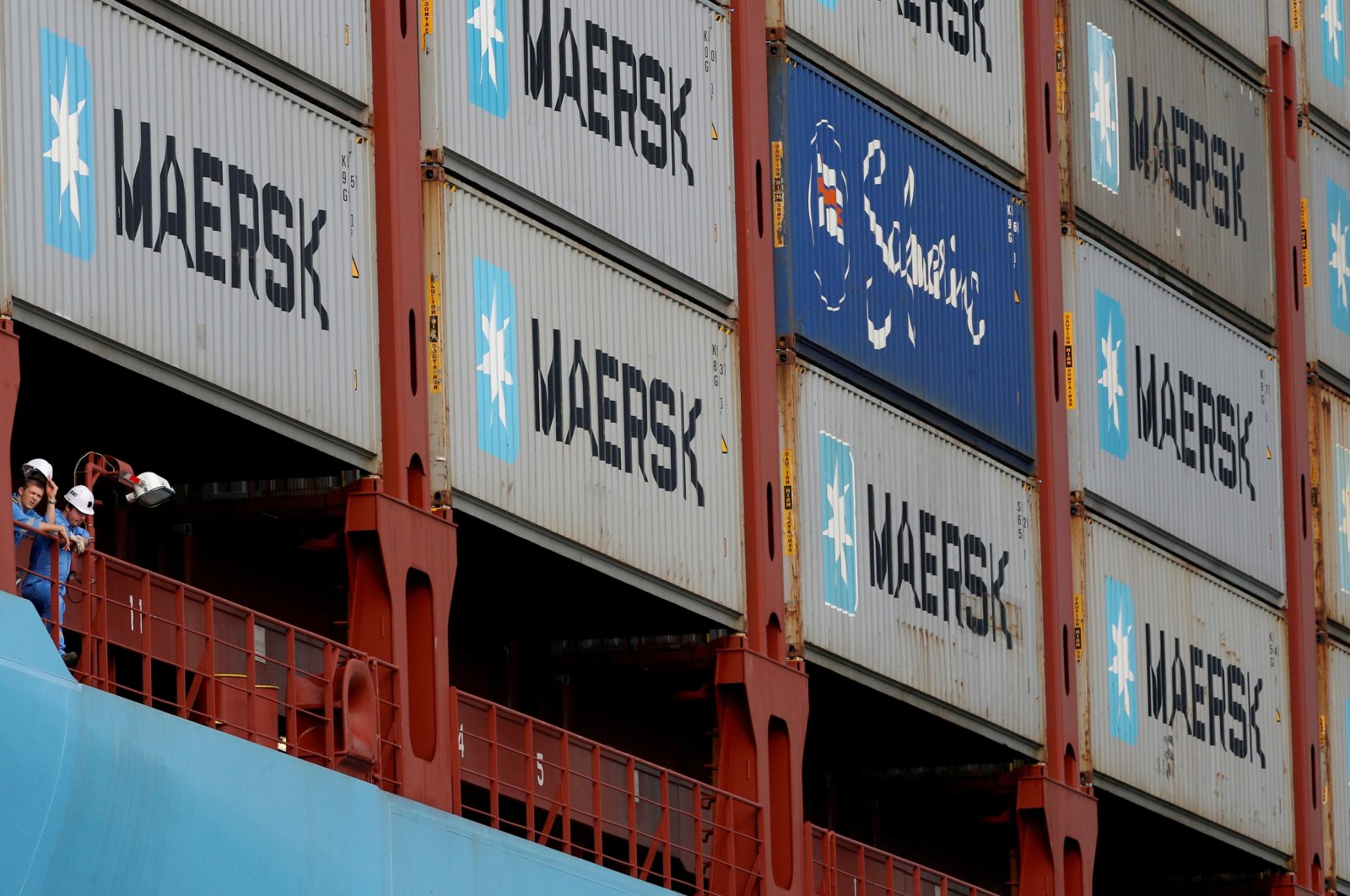 Crew members look out from the MV Maersk Mc-Kinney Moller as it berths at a PSA International port terminal in Singapore, Sept. 27, 2013. (Reuters Photo)