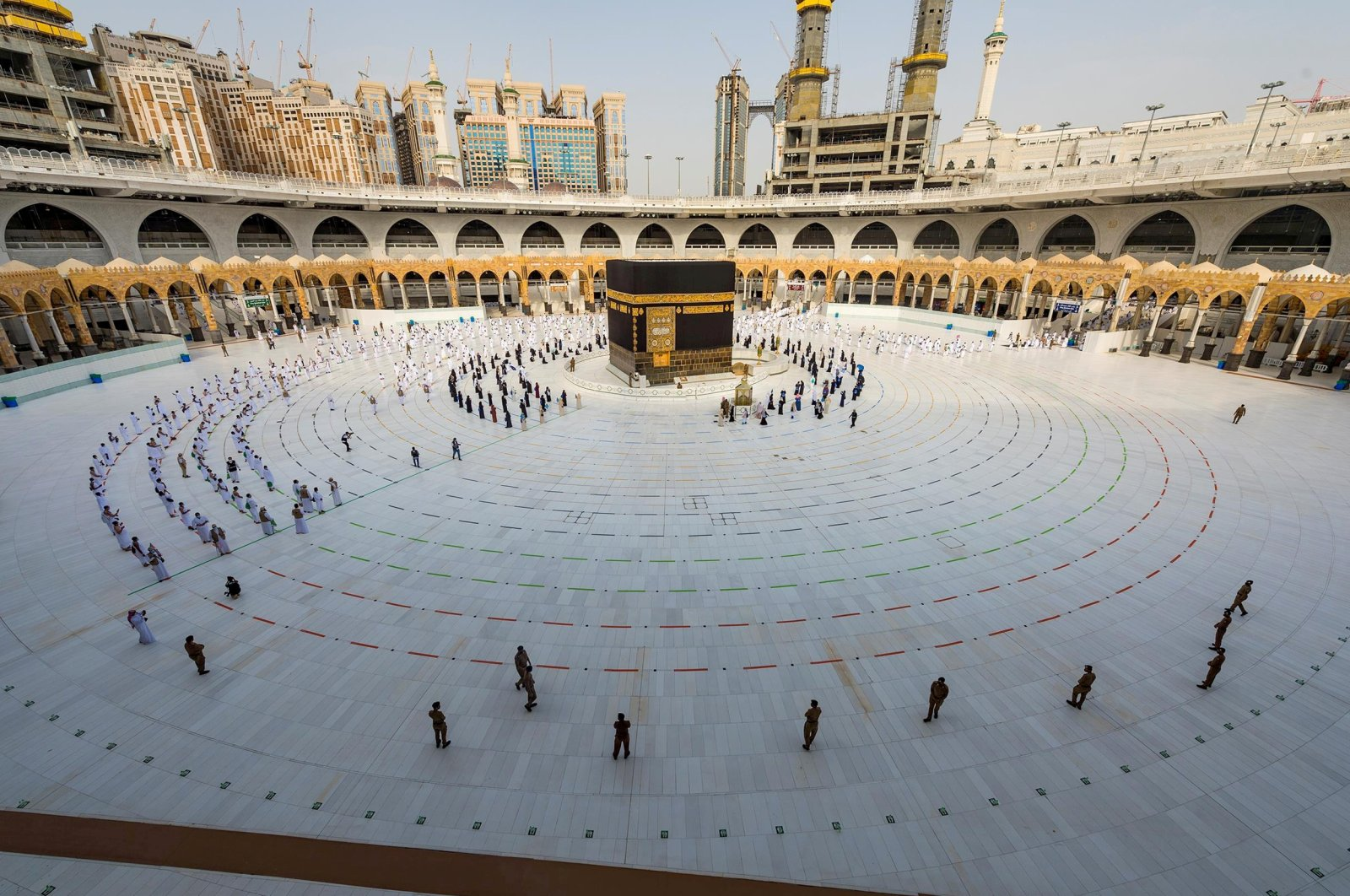 Muslim pilgrims wearing face masks and keeping social distance pray facing Kaaba during the annual Hajj pilgrimage amid the COVID-19 pandemic, in the holy city of Mecca, Saudi Arabia, July 31, 2020. (Reuters Photo)