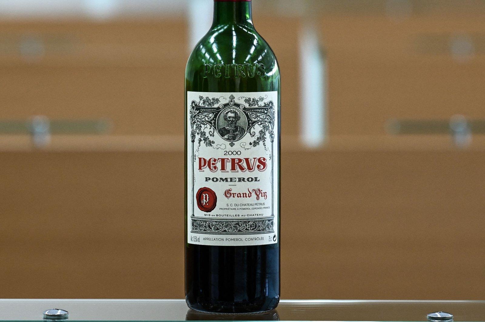 A bottle of Petrus that went into space is displayed at the University of Bordeaux Institut des Sciences de la Vigne et du Vin (Institute of Vine & Wine Science) in Villenave-d'Ornon, on the outskirts of Bordeaux, southwestern France, March 1, 2021. (AFP Photo)