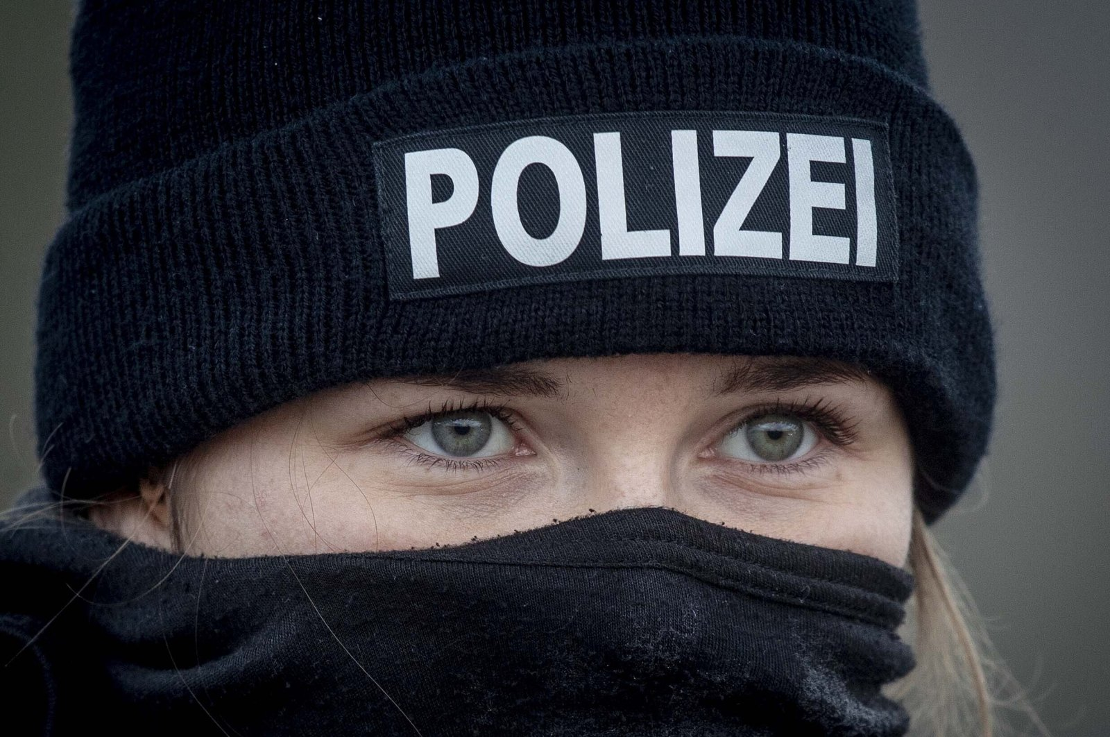 A German police officer stands guard at the train station in Biblis, Germany, Nov. 4, 2020. (AP Photo)