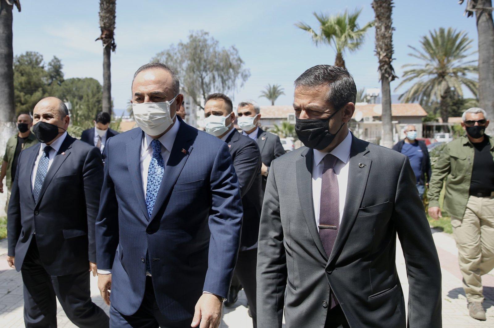 Foreign Minister Mevlüt Çavuşoğlu (L) and Turkish Republic of Northern Cyprus (TRNC) Foreign Minister Tahsin Ertuğruloğlu in TRNC, April 16, 2021 (AA Photo)
