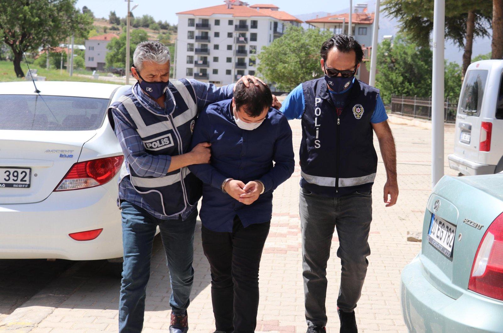 Halil Baki Çelen (C) is arrested by Turkish police in Denizli, Turkey, May 5, 2021. (DHA Photo)