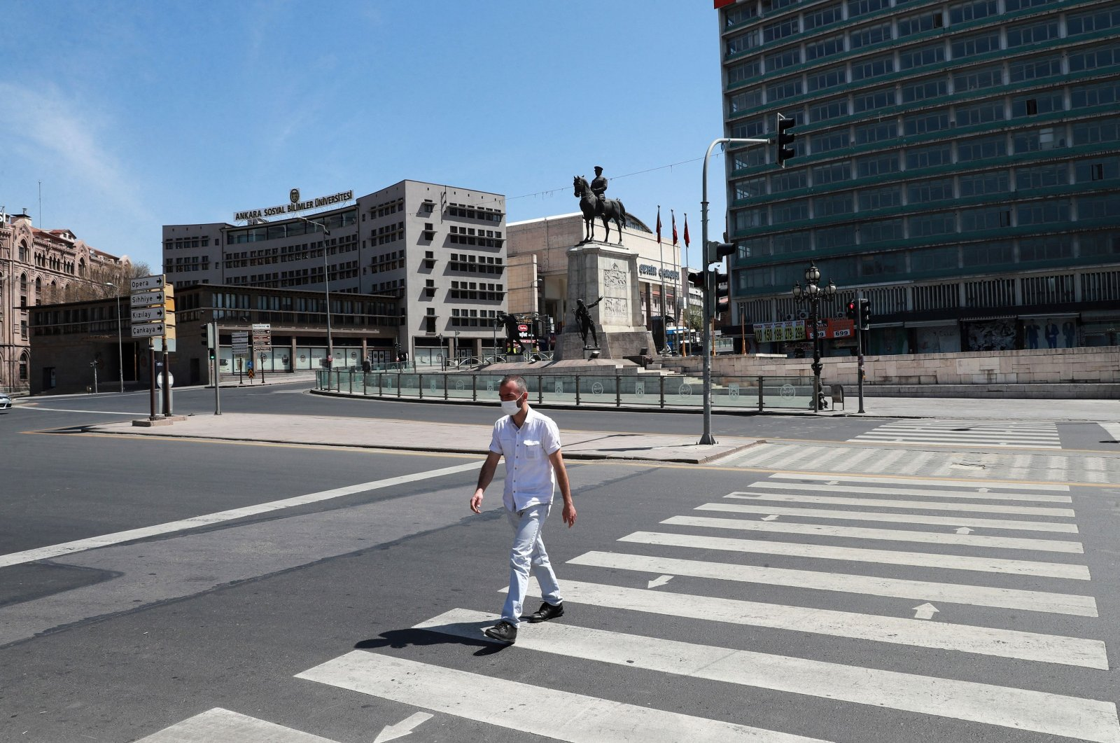 A man walks on a zebra crossing at an empty junction during the nationwide total lockdown, Ulus, Ankara, Turkey, May 1, 2021. (AFP Photo)
