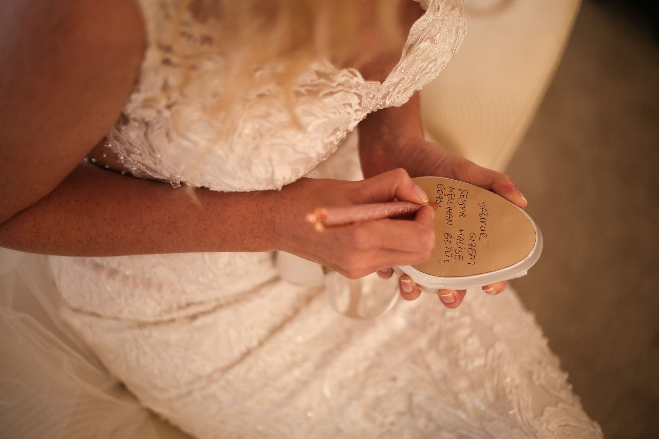It is customary for the bride to write her friends' names under her shoe before the wedding. (Shutterstock Photo)
