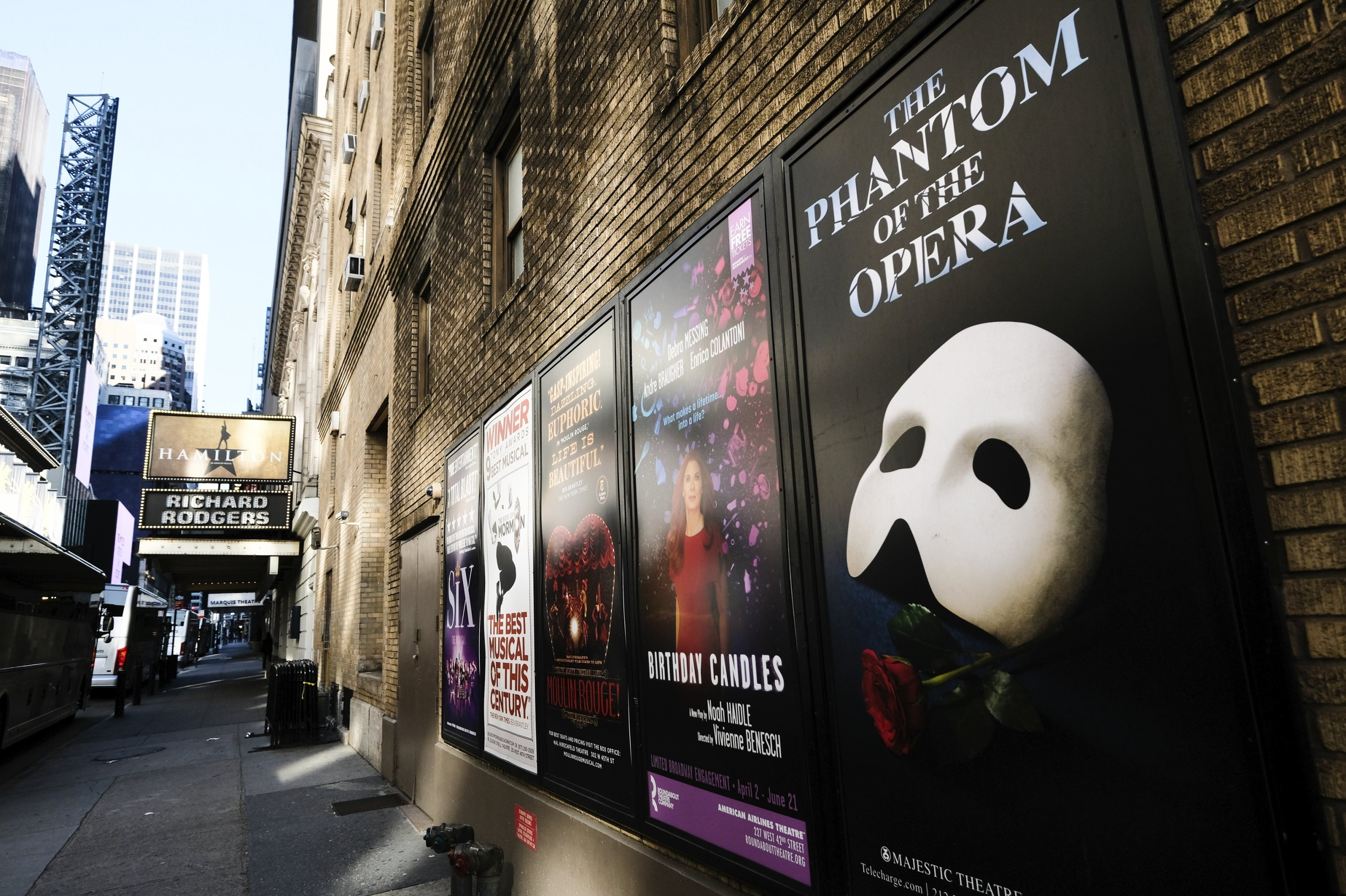 Broadway posters hang outside the Richard Rodgers Theatre during COVID-19 lockdown in New York, U.S., May 13, 2020. (AP Photo)