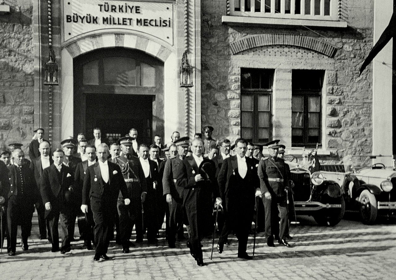 President Atatürk and his colleagues leaving the building of the Grand National Assembly of Turkey after a meeting for the seventh anniversary of the foundation of the Republic of Turkey in 1930.