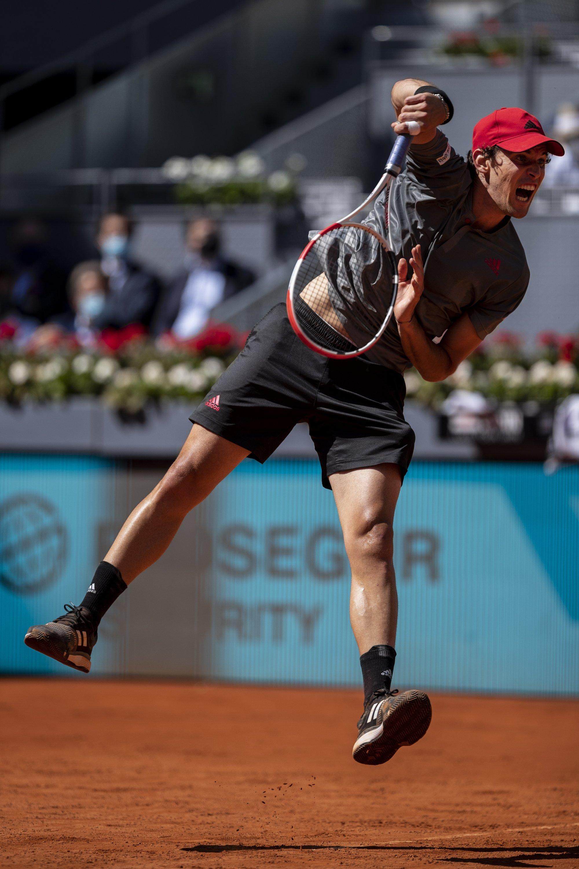Austria's Dominic Thiem serves the ball to Australia's Alex de Minaur during the Madrid Open, Madrid, Spain, May 6, 2021. (AP Photo)
