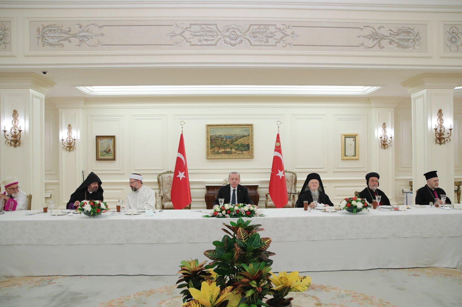 President Recep Tayyip Erdoğan (C) attends an iftar dinner with representatives of Turkey's minority communities at the Presidential Complex in Ankara, Turkey, May 5, 2021. (AA Photo)