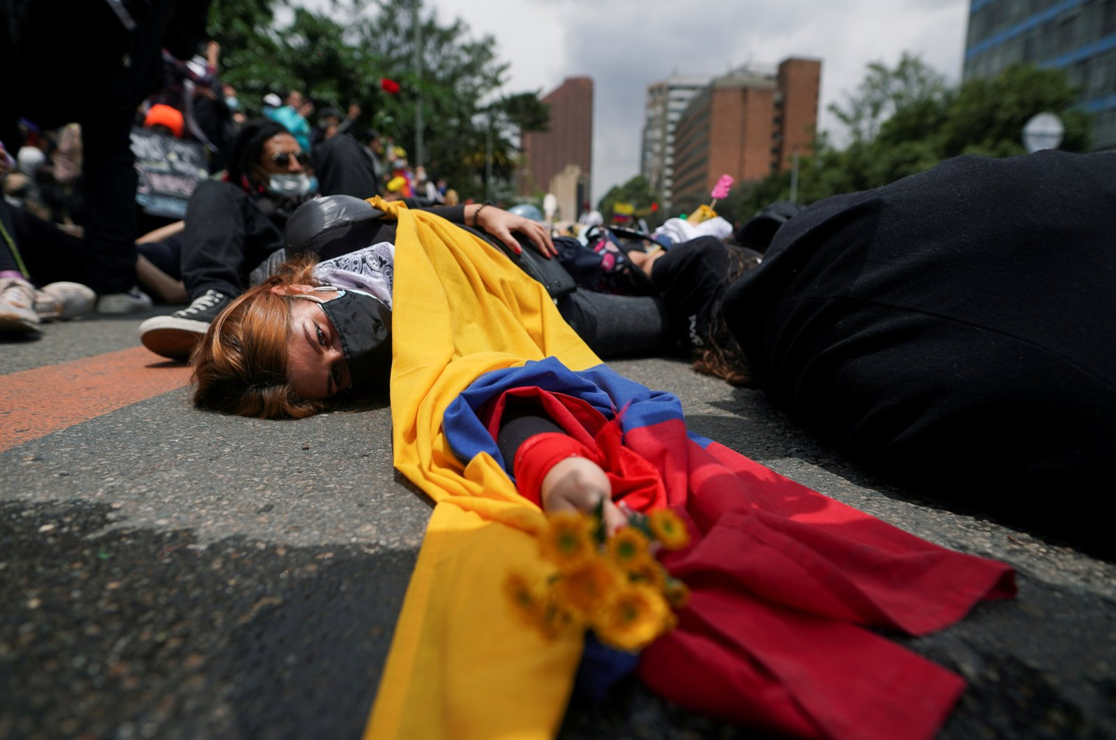 Demonstrators participate in a protest against poverty and police violence in Bogota, Colombia, May 5, 2021. (Reuters Photo)