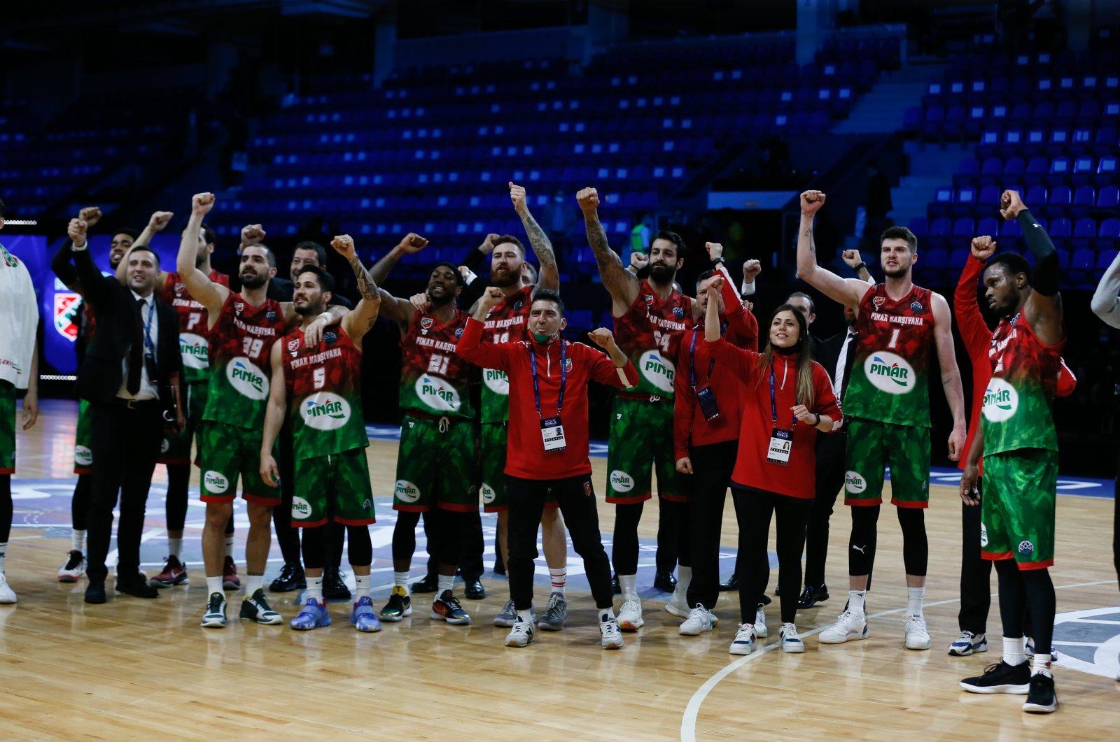 The Pınar Karşıyaka squad celebrates after its FIBA Basketball Champions League quarterfinal victory against Czech club ERA Nymburk at the Entertainment Complex Nagorny in Nizhny Novgorod, Russia, May 5, 2021. (AA Photo)