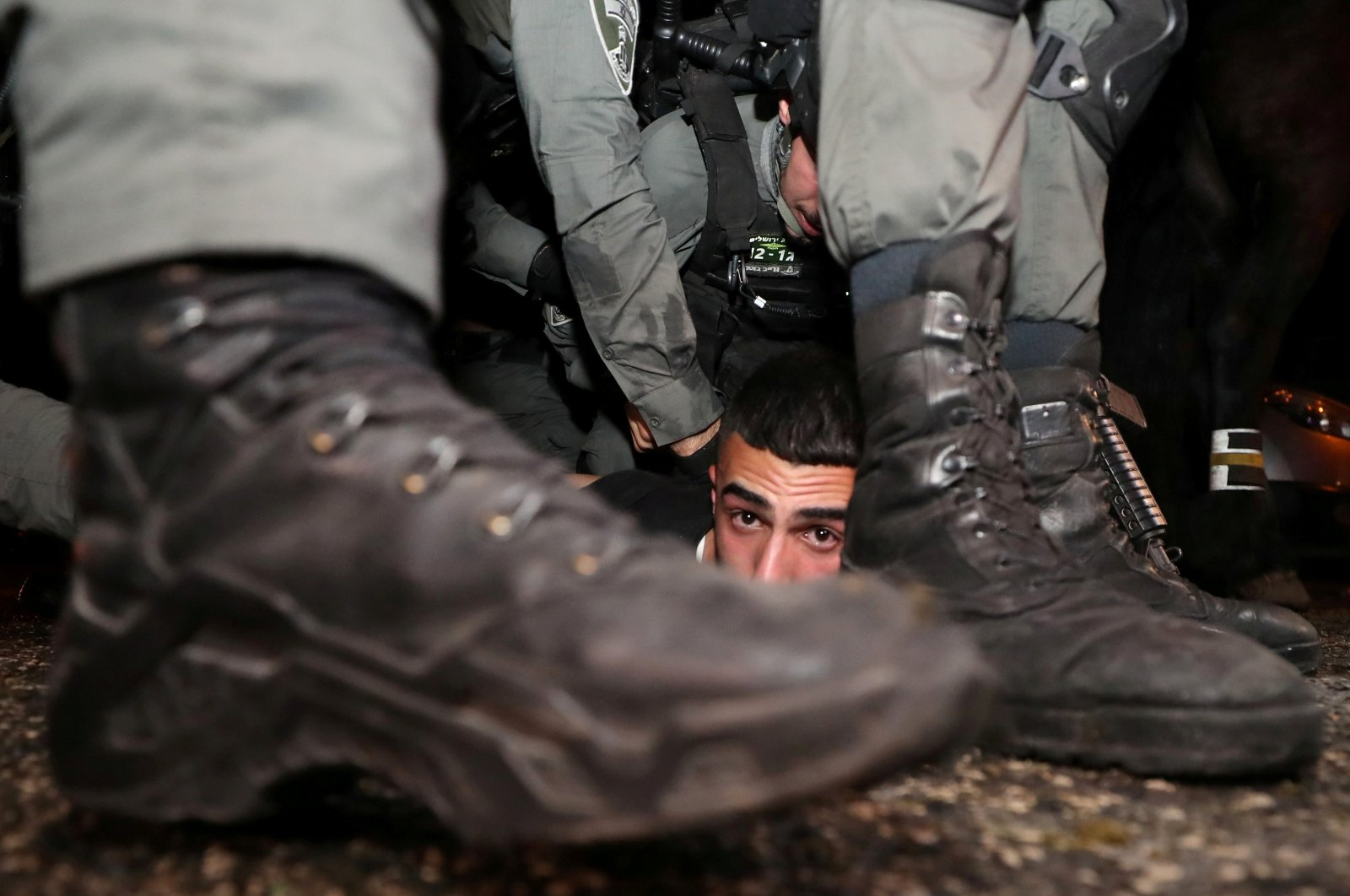 Israeli police detain a Palestinian protester amid ongoing tension ahead of an upcoming court hearing in an Israel-Palestinian land-ownership dispute in the Sheikh Jarrah neighborhood of occupied East Jerusalem, May 5, 2021. (Reuters Photo)