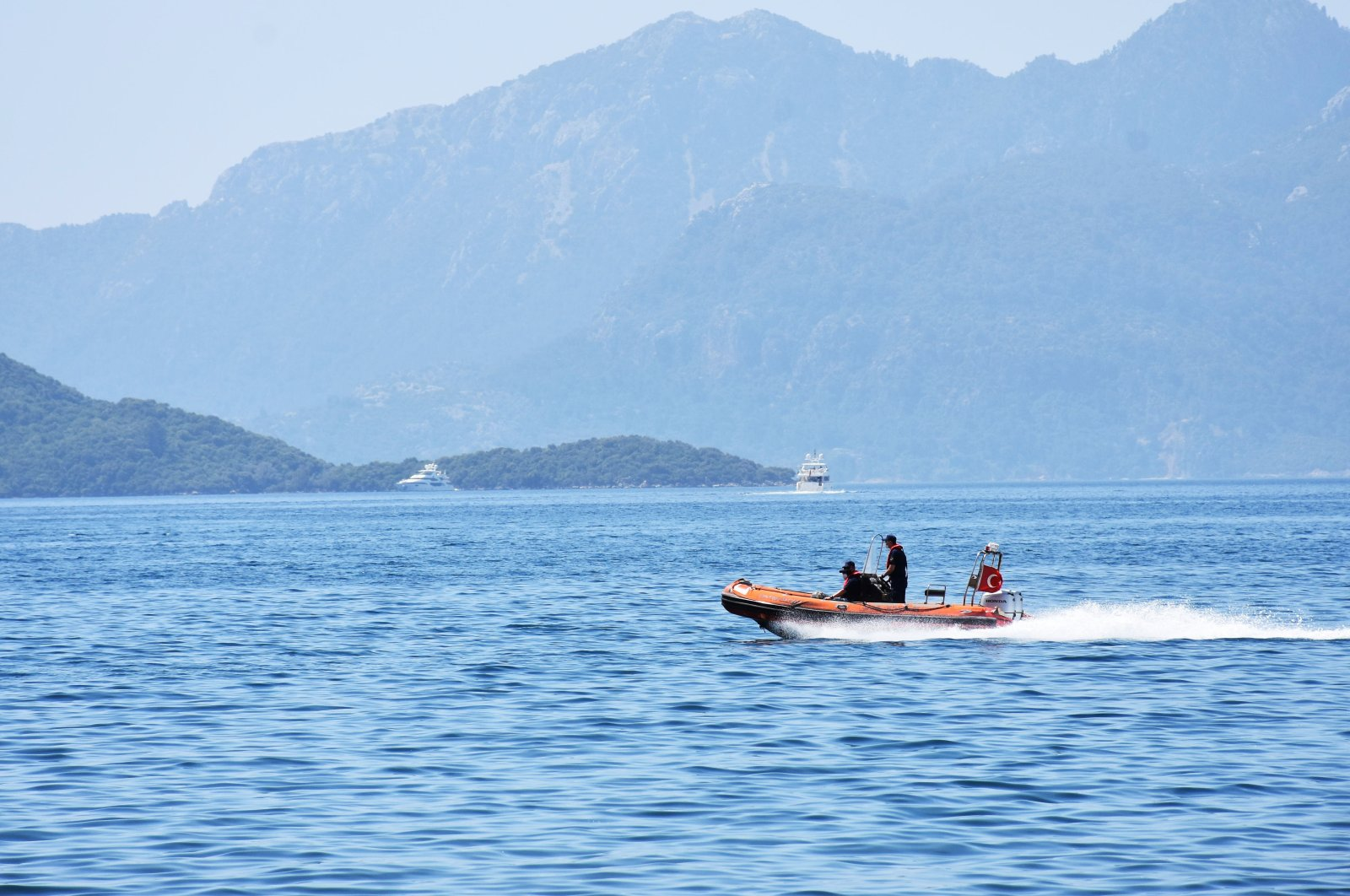 """The Turkish coast guard patrols the touristic Marmaris district during the """"full closure,"""" excluding tourists, imposed to curb the spread of COVID-19, Muğla, southwestern Turkey, May 3, 2021. (AA Photo)"""