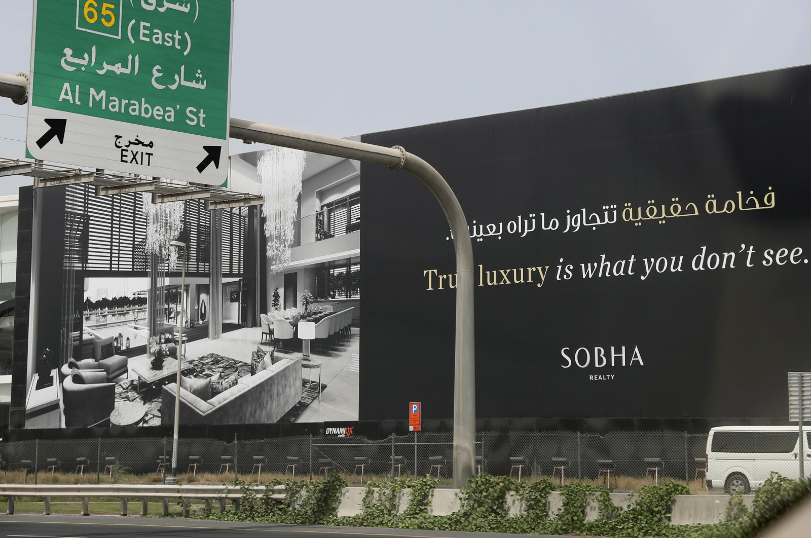 A billboard advertises a luxury residential project along a highway in Dubai, United Arab Emirates, May 5, 2021. (AP Photo)