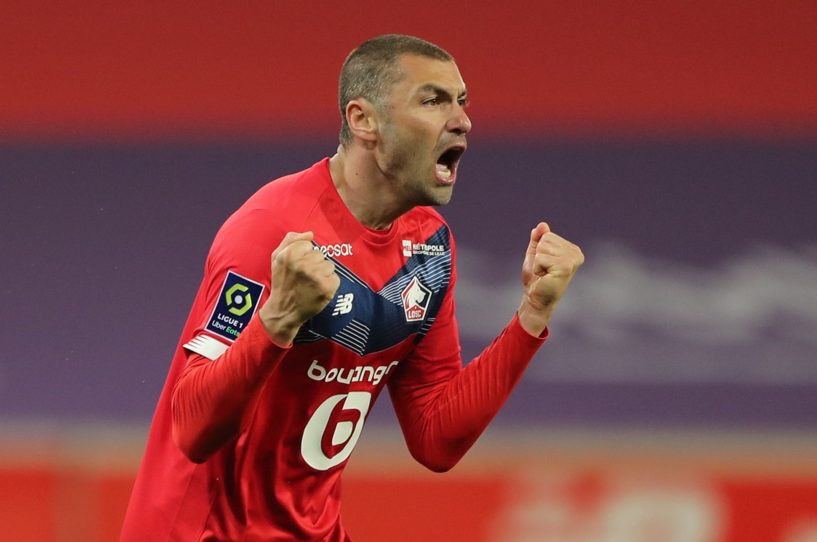 Lille's Turkish Forward Burak Yilmaz celebrates a goal againstNice atStade Pierre-Mauroy, Lille, France, May 1, 2021. (Reuters Photo)