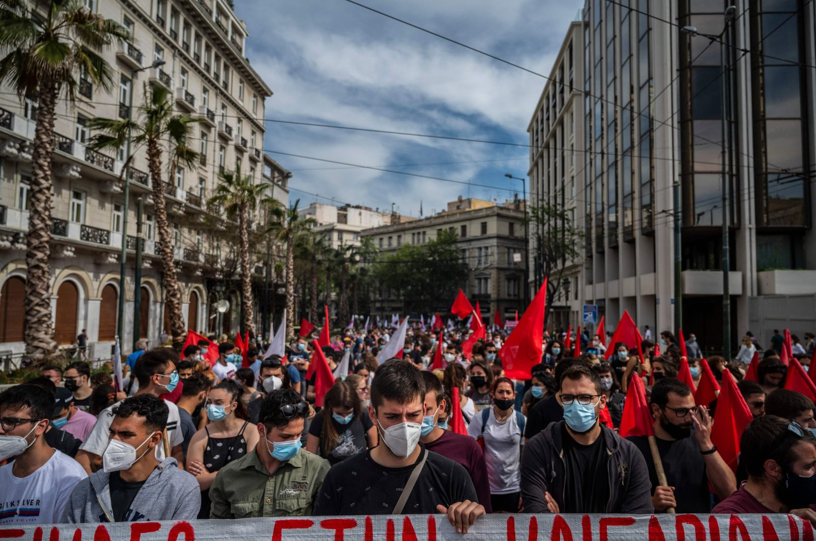 Demonstrators wearing protective face masks against the coronavirus and members of the Greek Labour Union (PAME) protest during a strike against the new Labour law, in central Athens, May 6, 2021. (AFP Photo)