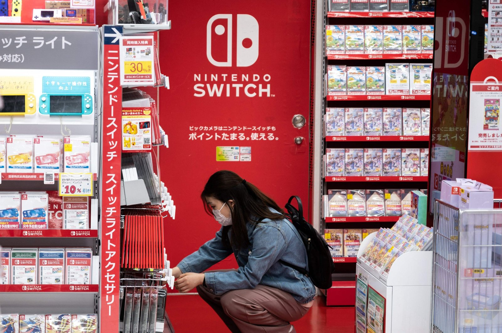 A customer browses the gaming section of Nintendo products in a shop in Tokyo, Japan, May 6, 2021. (AFP Photo)