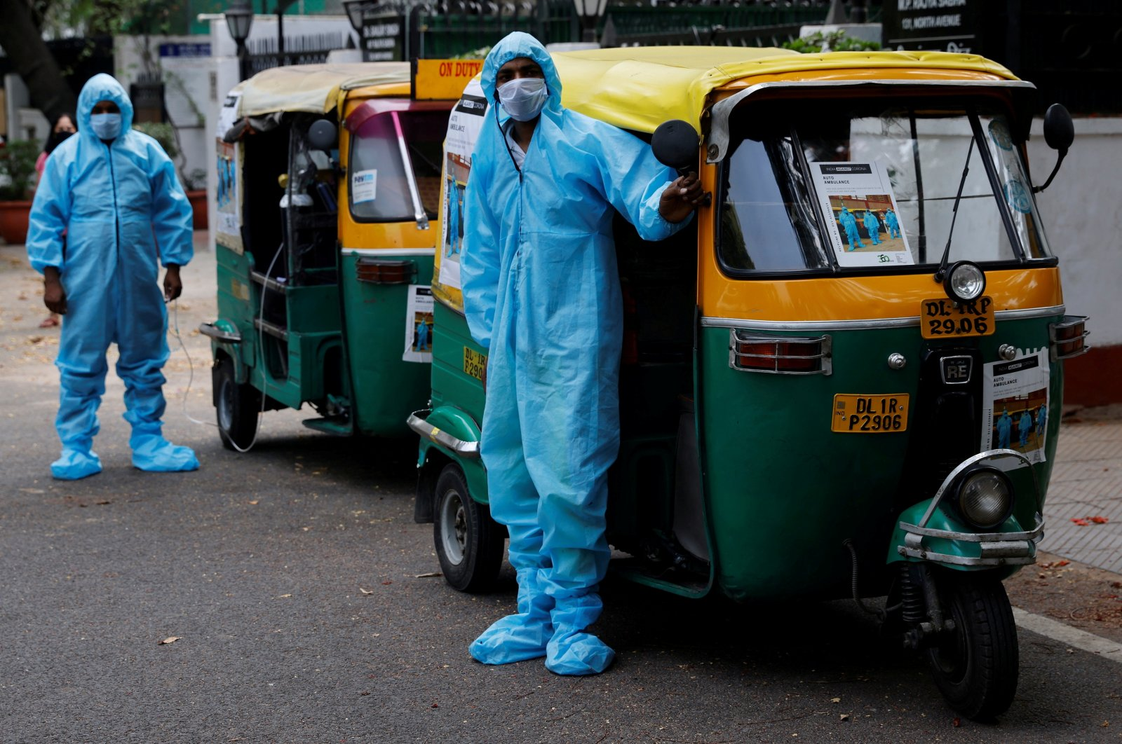 Drivers stand near autorickshaw ambulances, prepared to transfer people suffering from the coronavirus and their relatives for free, in New Delhi, India, May 5, 2021. (Reuters / Adnan Abidi Photo)