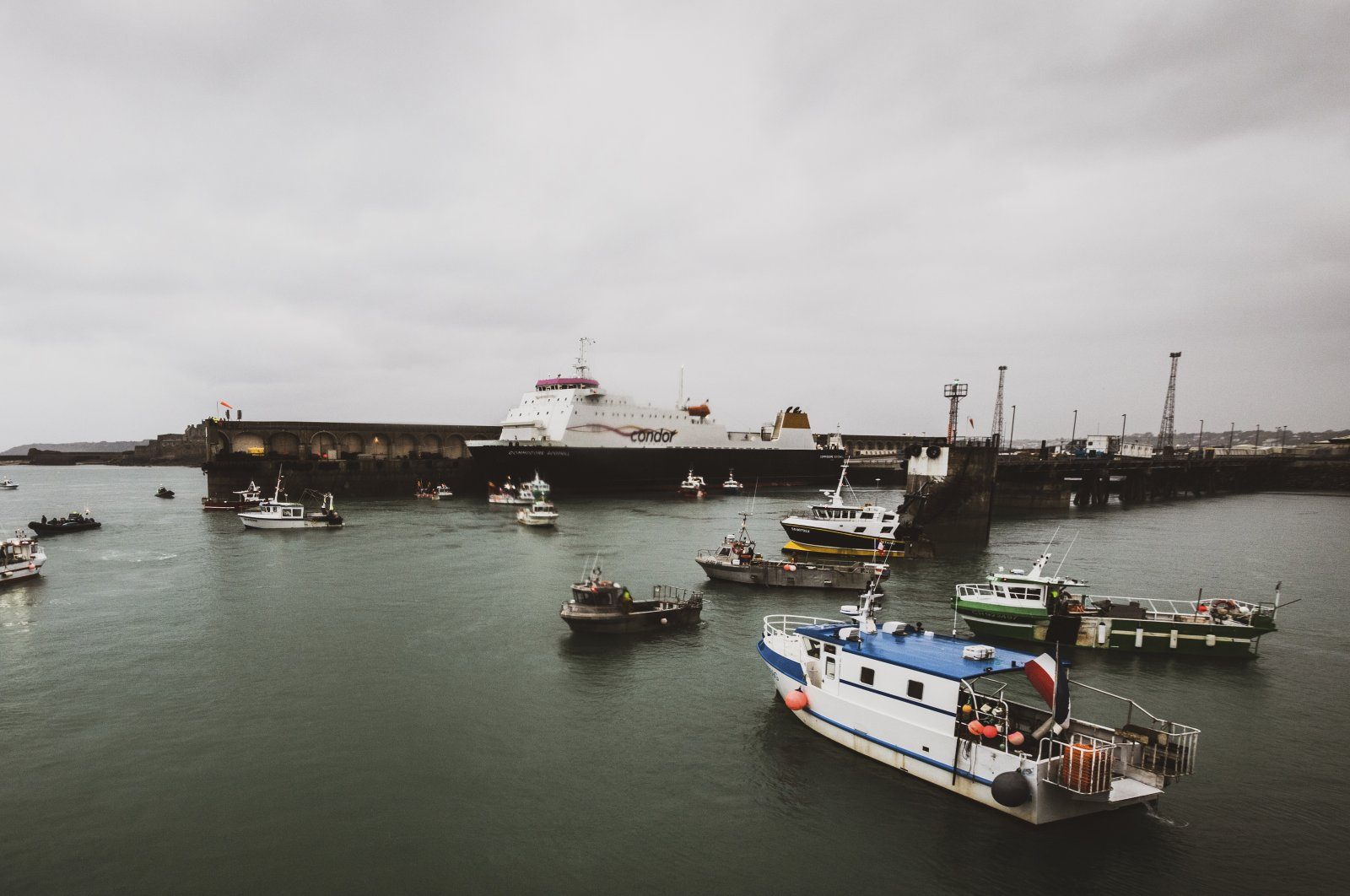 French fishing vessels block the port of St. Helier in Jersey, Thursday, May 6, 2021. (Oliver Pinel via AP)