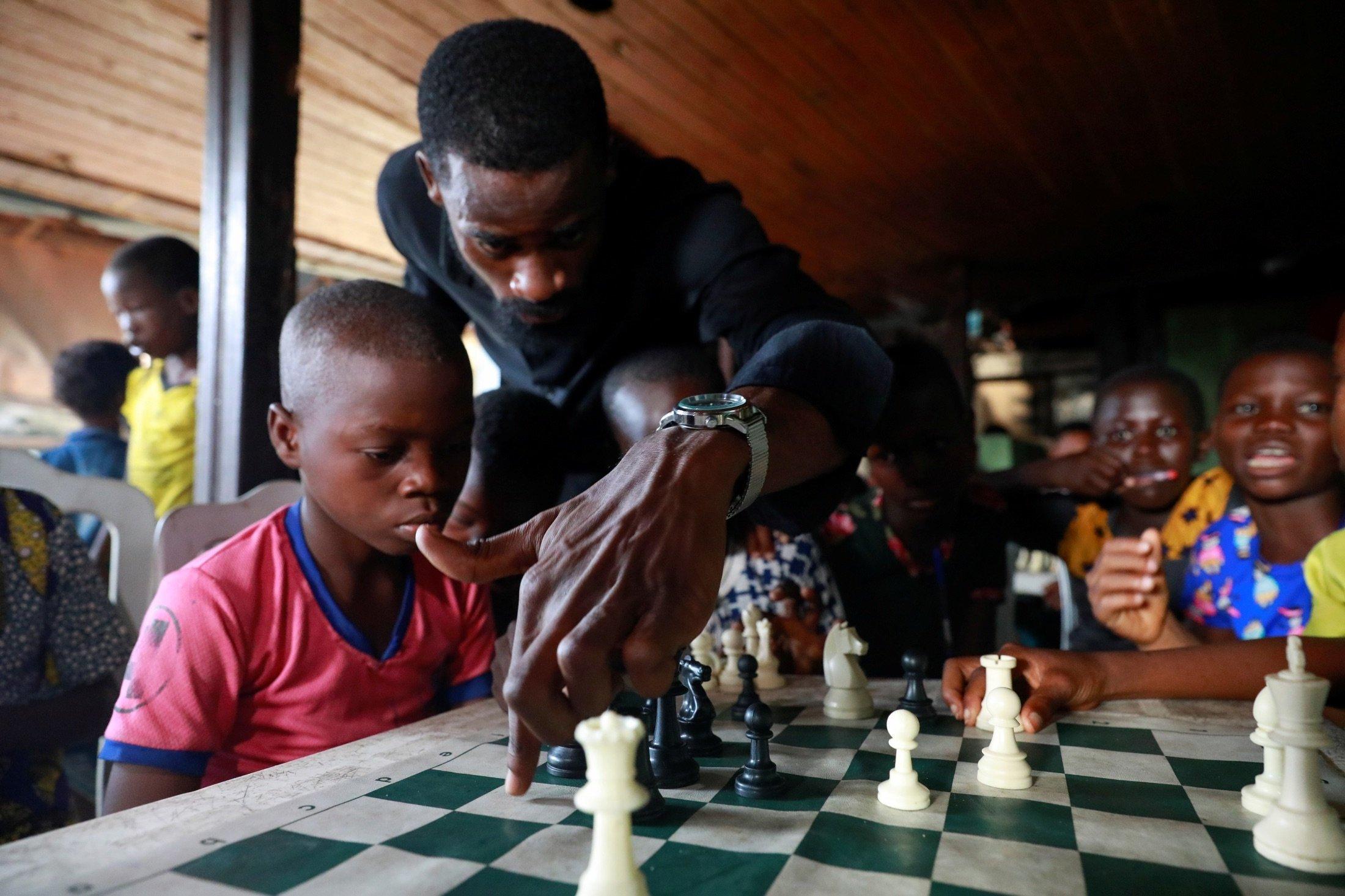 Babatunde Onakoya, 26, teaches children to play chess at a community palace in Makoko, Lagos, Nigeria, May 5, 2021. (Reuters Photo)