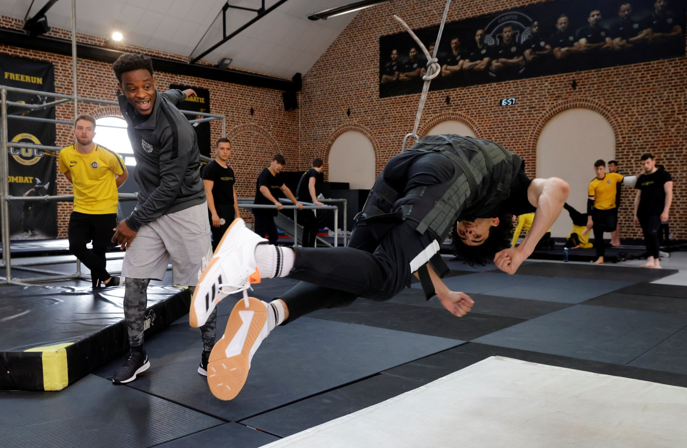 CUC parkour and free-running coach Malik Diouf coaches students during a stunt wire session at France's Campus Univers Cascade (CUC), a training ground for stuntpeople, in Le Cateau-Cambresis, France, May 4, 2021. (Reuters Photo)