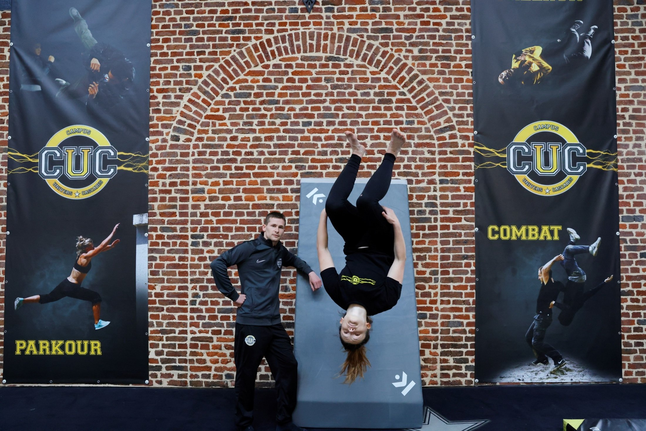 CUC director Lucas Dollfus poses next to student Zoe Simonnuti during a training session at France's Campus Univers Cascade (CUC), a training ground for stuntpeople, in Le Cateau-Cambresis, France, May 4, 2021. (Reuters Photo)