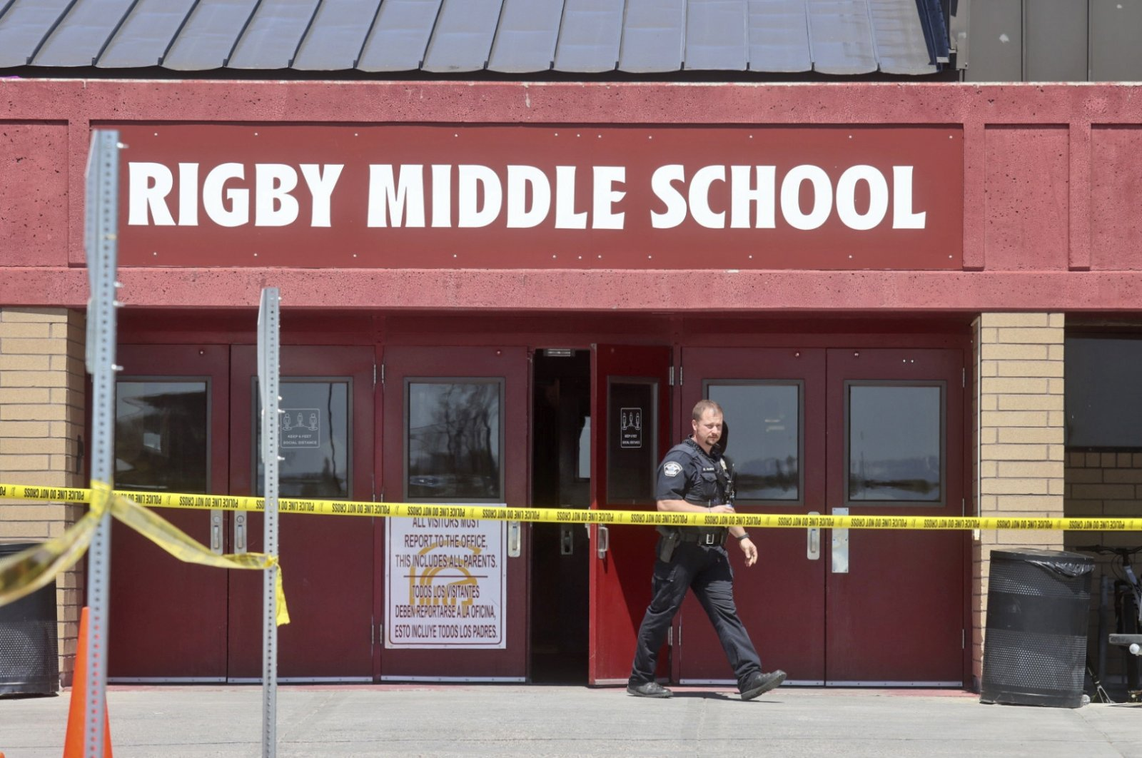 A police officer walks out of Rigby Middle School following a shooting there earlier, in Rigby, Idaho, U.S., May 6, 2021. (AP Photo)