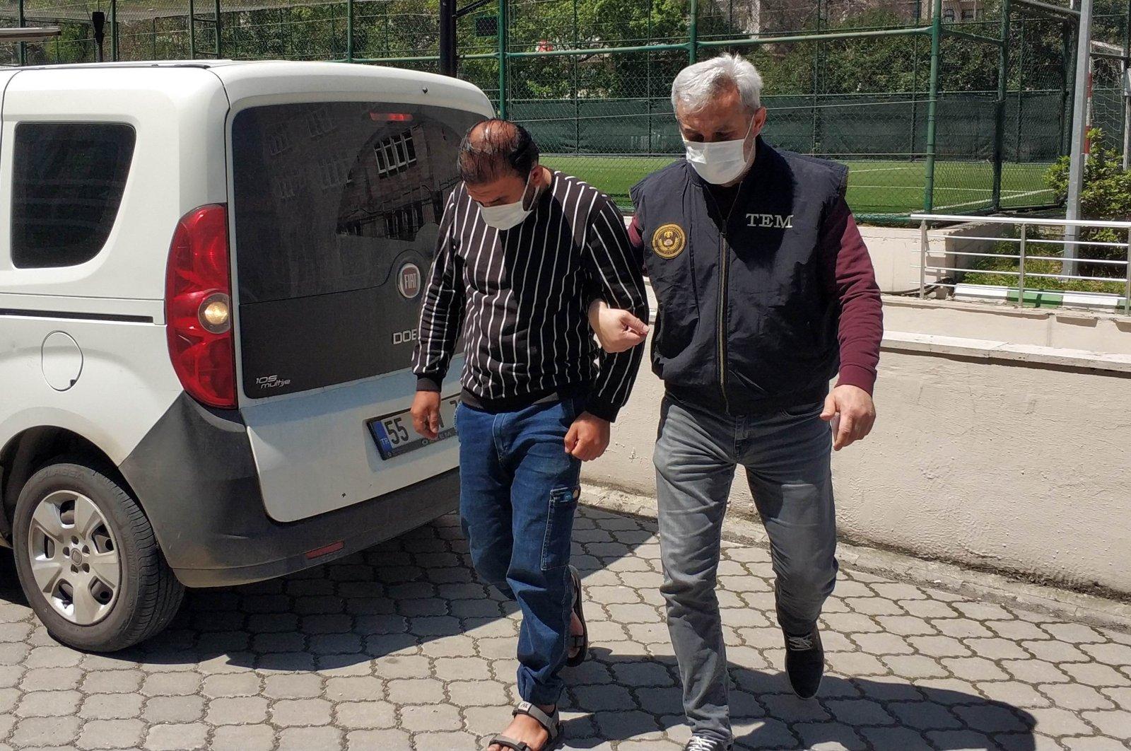 An Iraqi national (L) is taken into police custody under suspicion of having links to the Daesh terror group, northern Samsun province, Turkey, May 7, 2021. (IHA Photo)