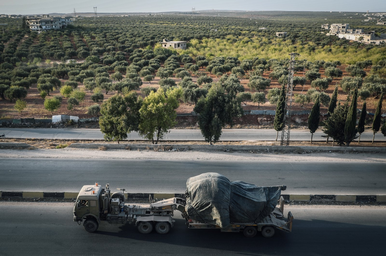 A Turkish military vehicle drives on the M4 Motorway, near the city of Arihah, Syria, Oct. 20, 2020. (Photo by Getty Images)