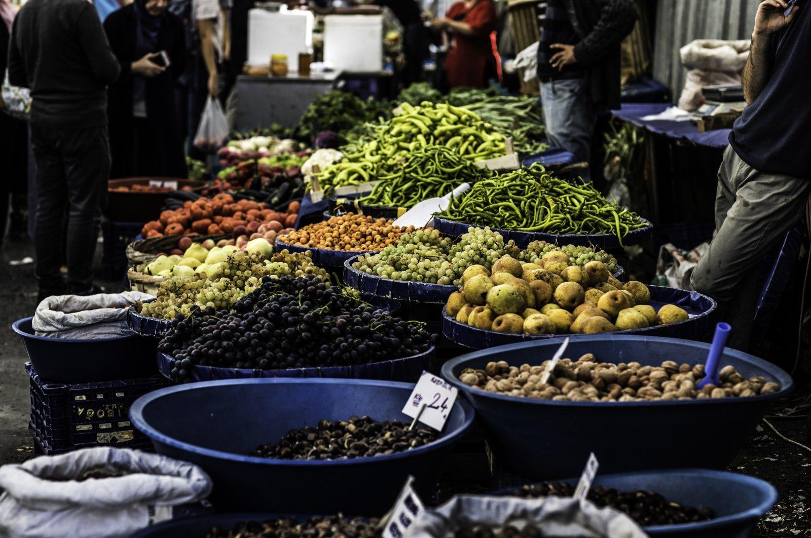 A vendor sells vegetables in the organic market in Kasımpaşa, Istanbul, Turkey, Oct. 13, 2019. (Getty Images)
