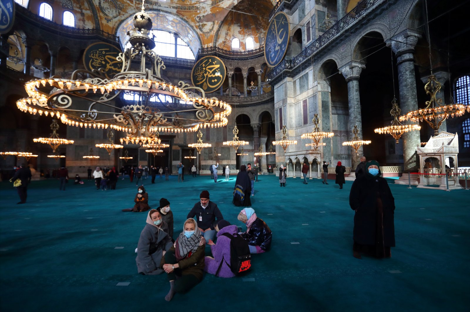 Russian tourists pause as they visit Ayasofya-i Kebir Camii, also known as the Hagia Sophia Grand Mosque, amid the coronavirus disease outbreak in Istanbul, Turkey, Jan. 29, 2021. (Reuters Photo)