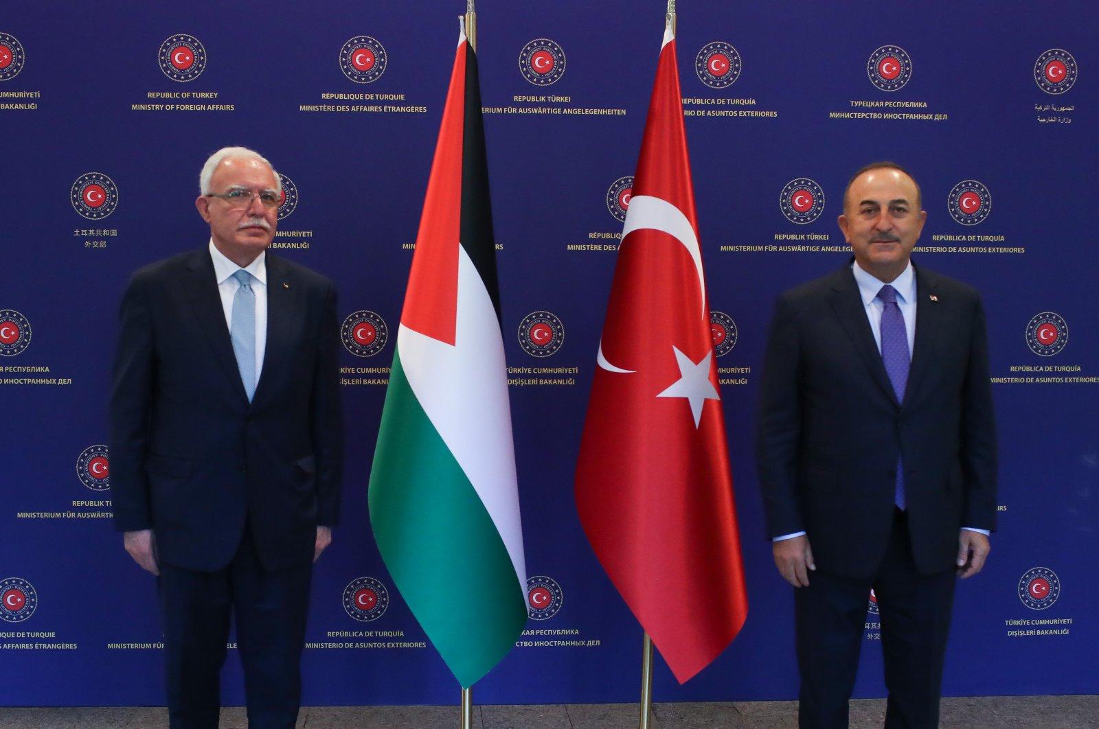 Foreign Minister Mevlüt Çavuşoğlu (R) with Palestinian Foreign Minister Riyad al-Maliki in the capital Ankara, May 7, 2021. (AA Photo)