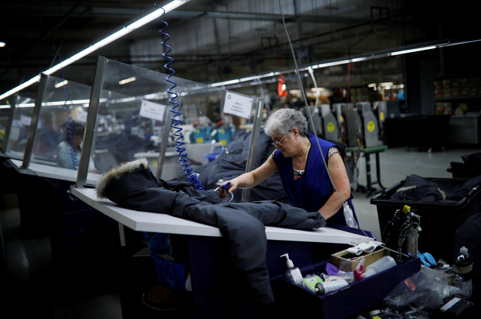 Workers make jackets at the Canada Goose factory in Toronto, Ontario, Canada, February 23, 2018. (Reuters Photo)